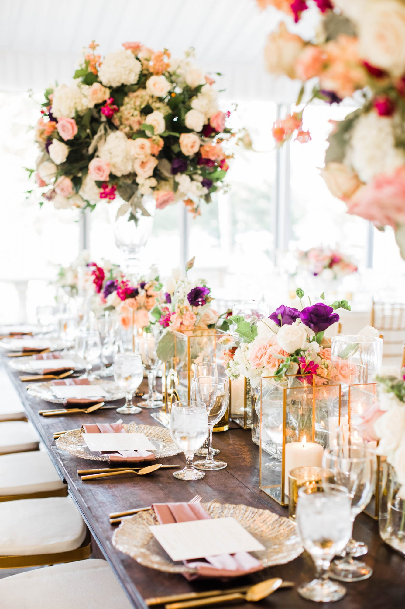 eggplant, fuchsia, pink, and white floral arrangement decor