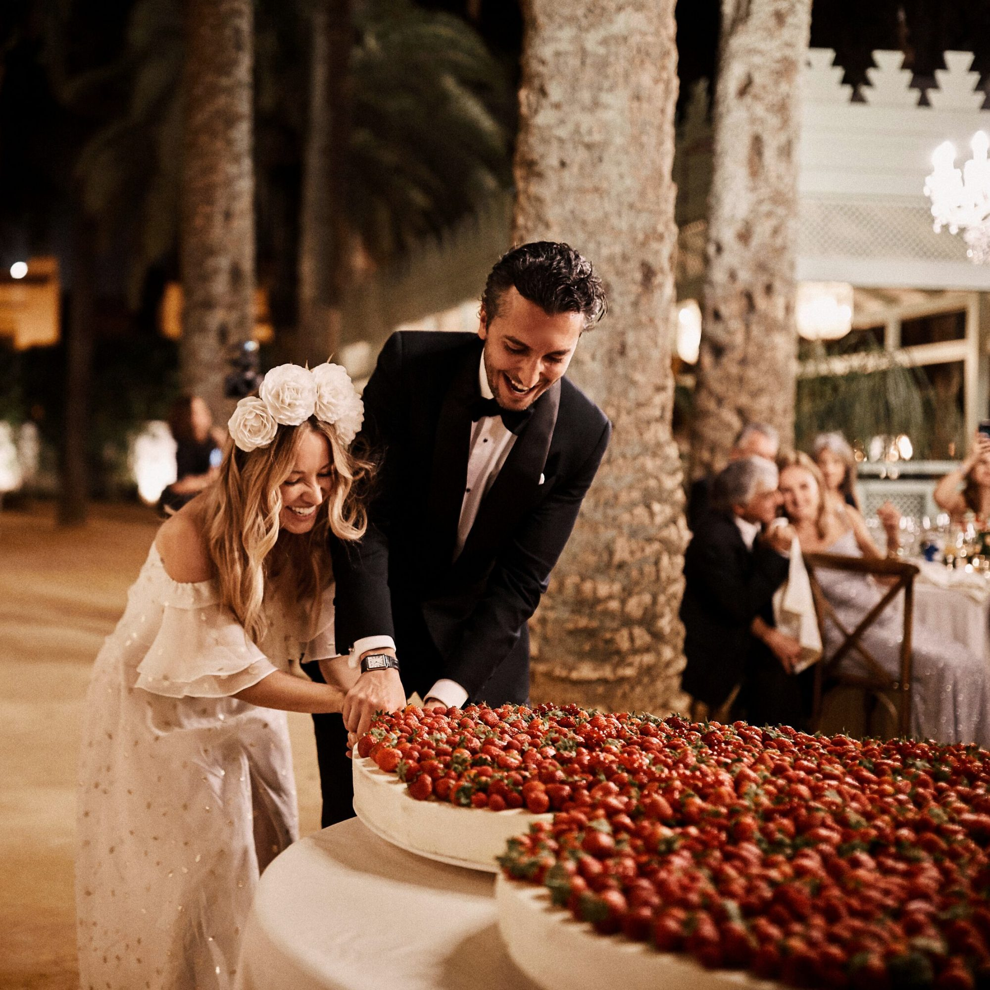 karolina sorab wedding bride groom cutting cake with strawberries