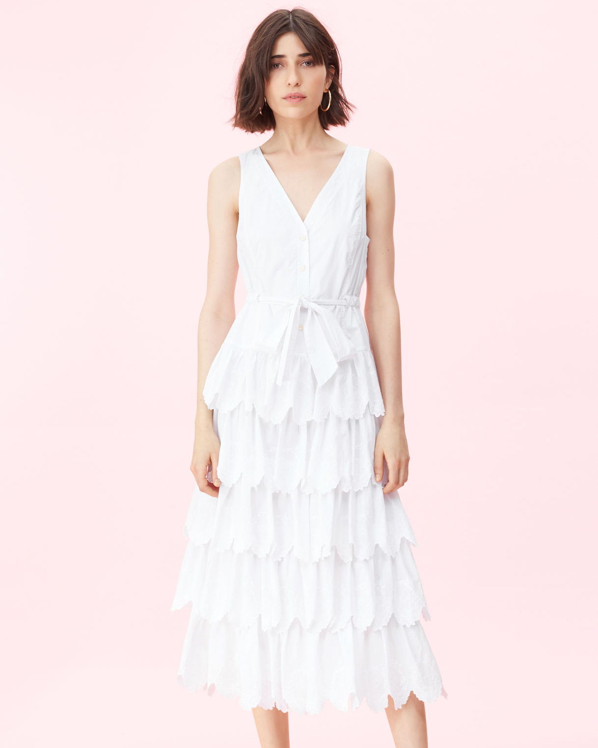 white sleeveless ruffled dress