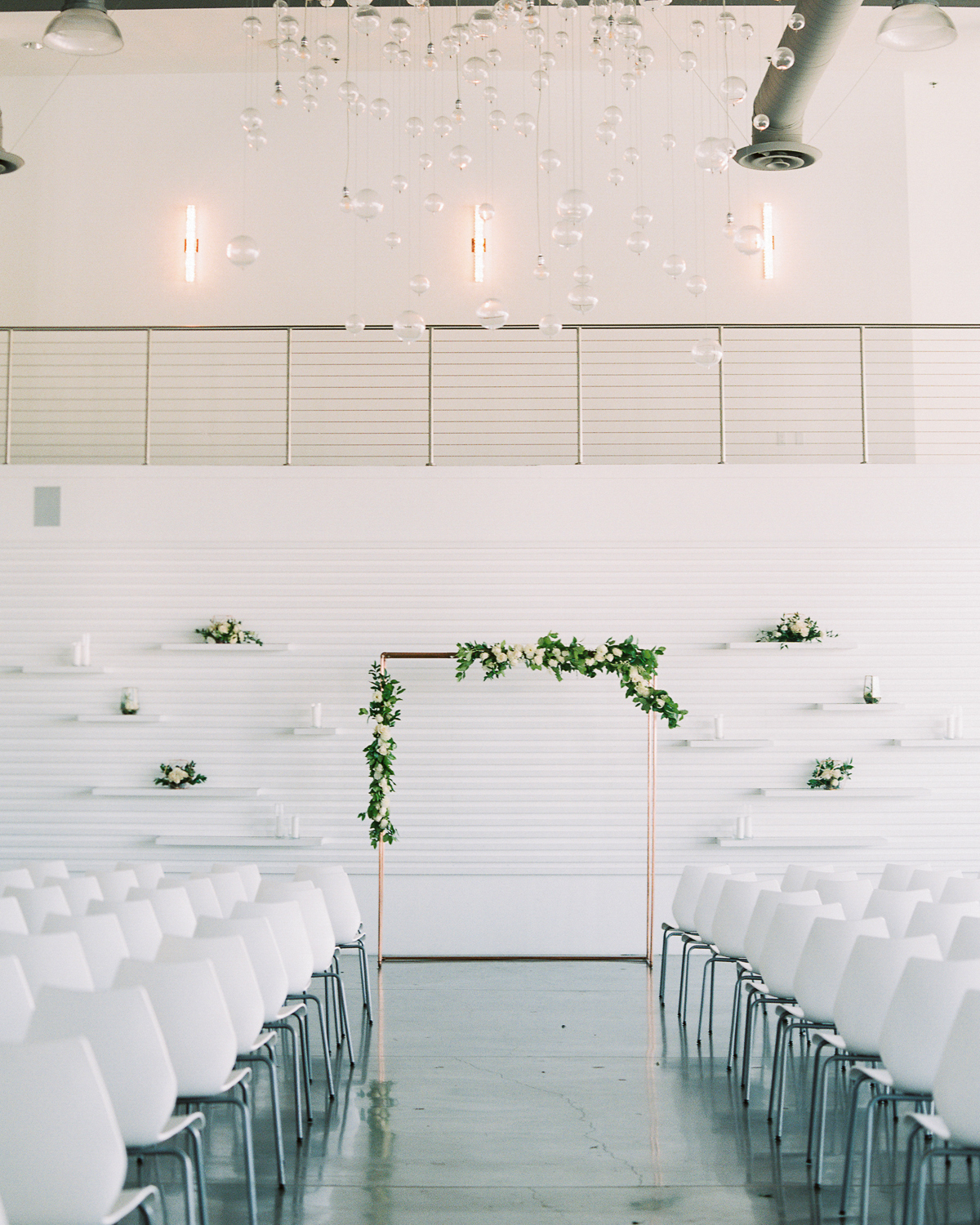 wedding ceremony aisle with copper arch