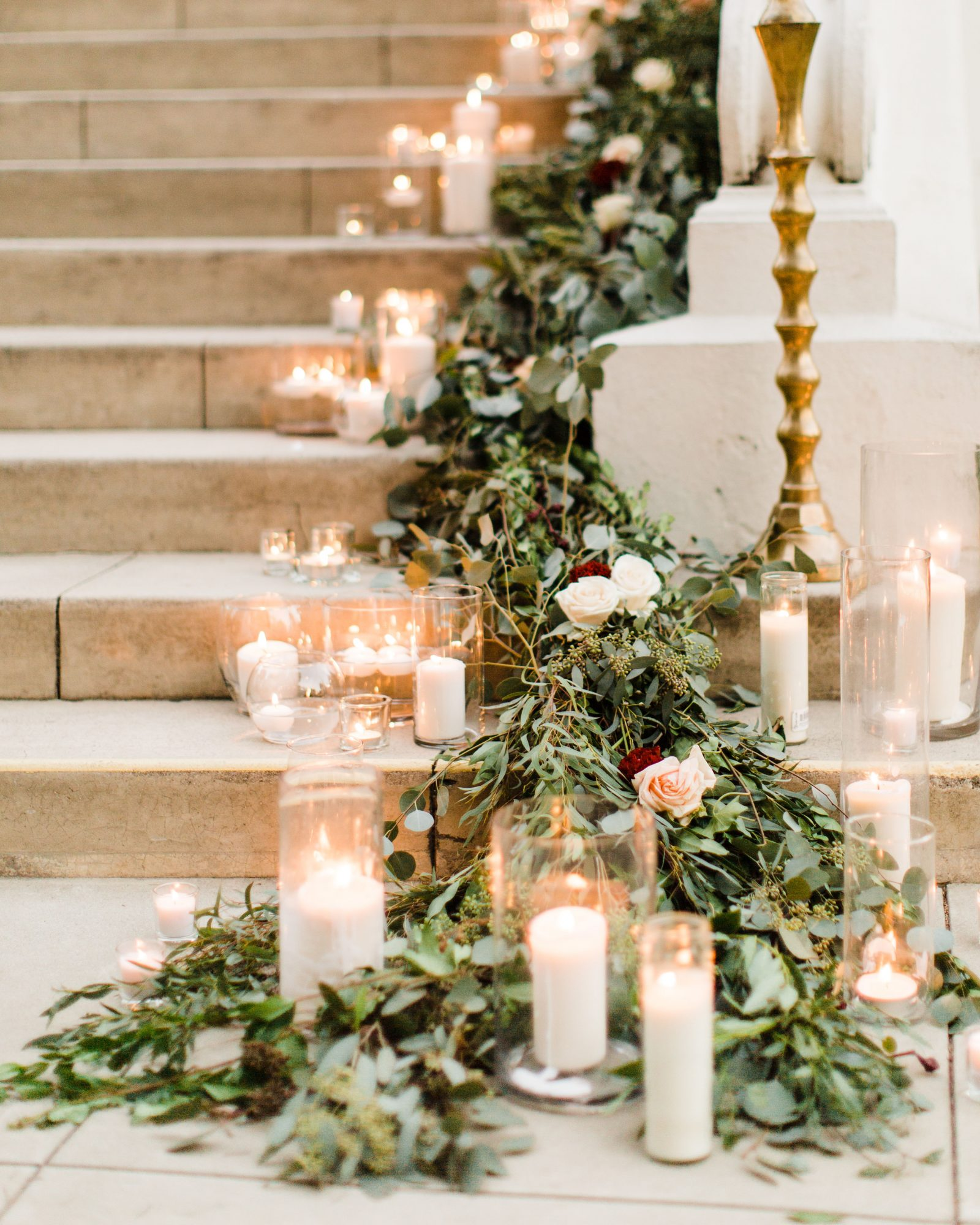 staircase banister decor candlelight greenery