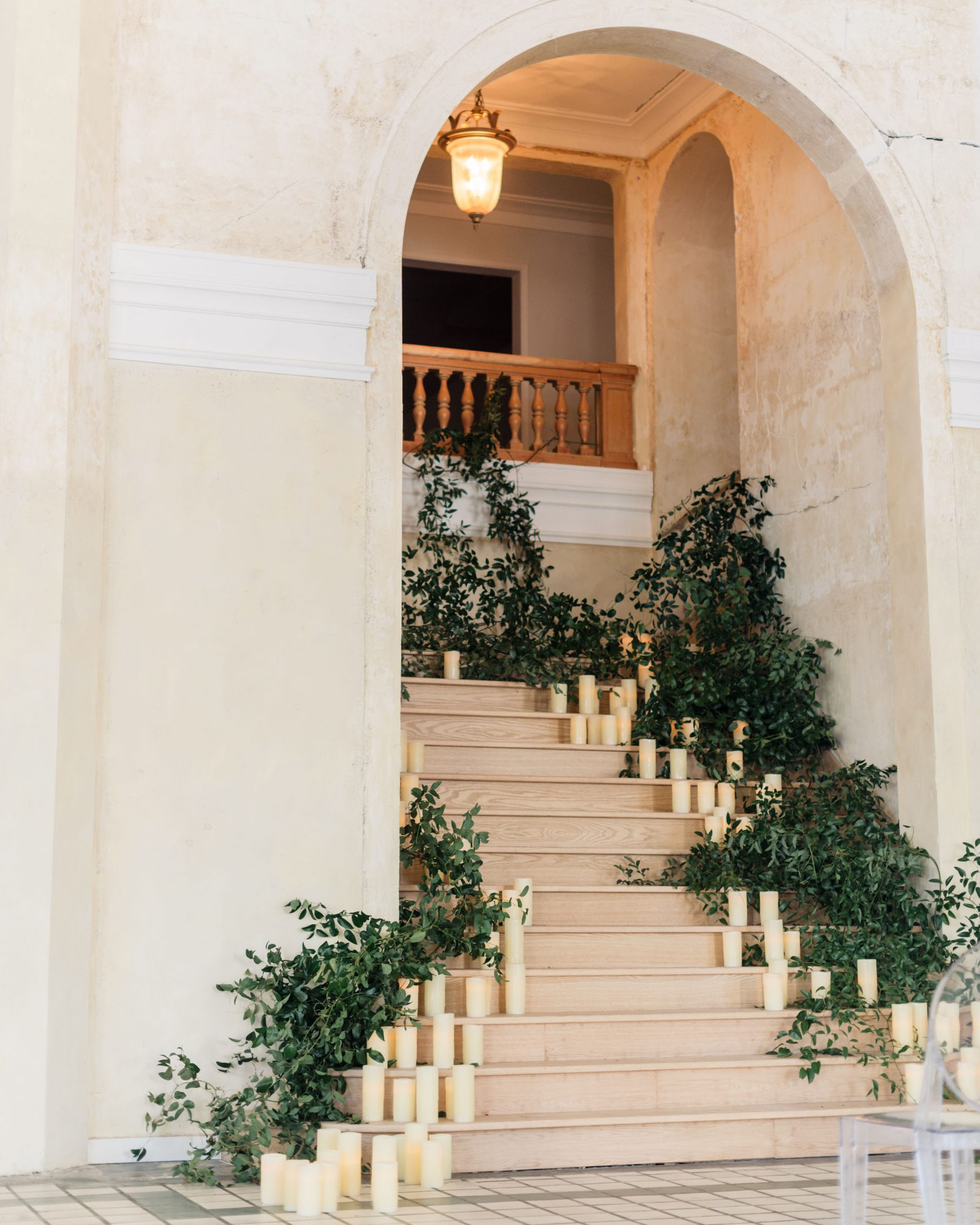 stair banister decor candles greenery arch entry