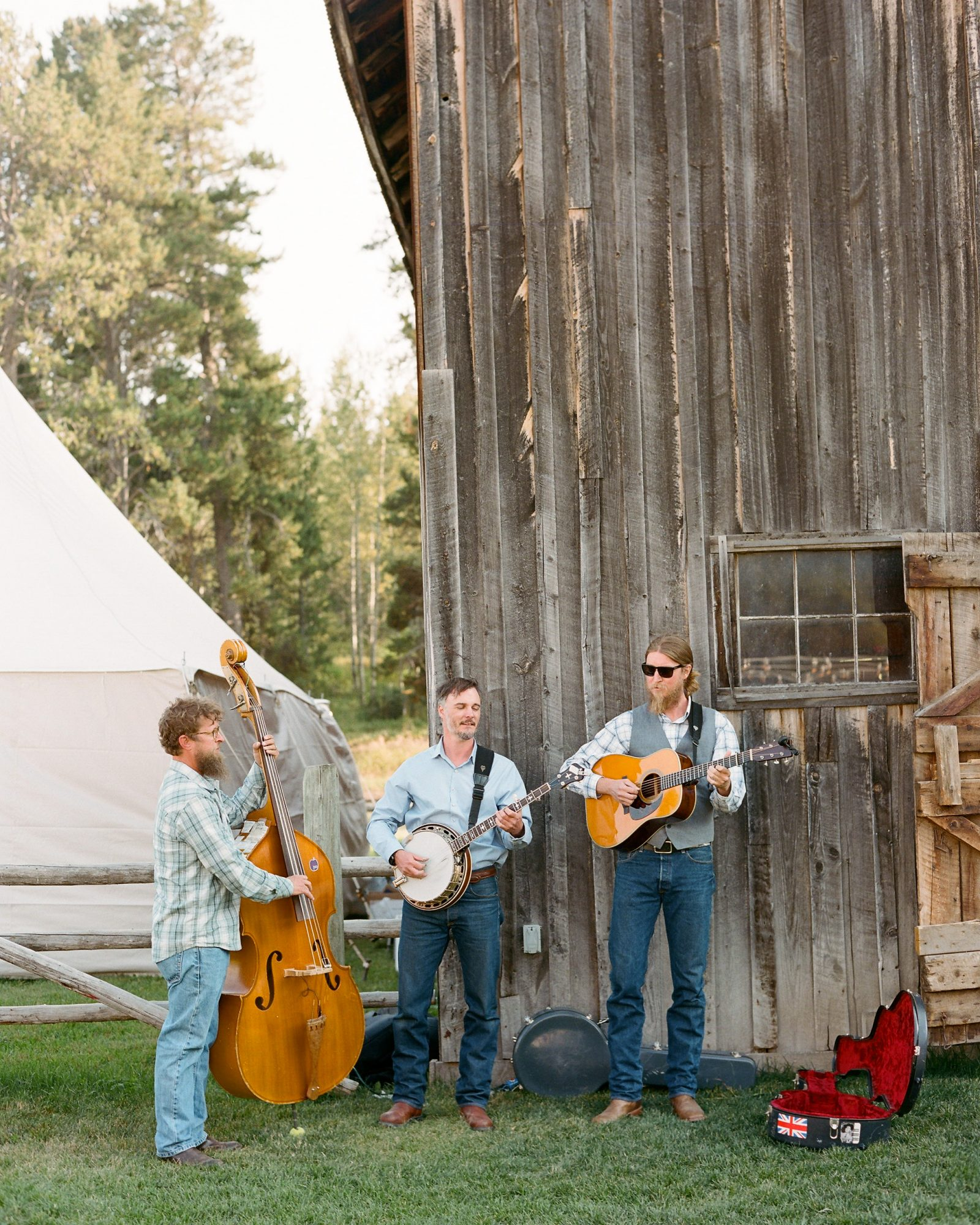 wedding band playing next to barn