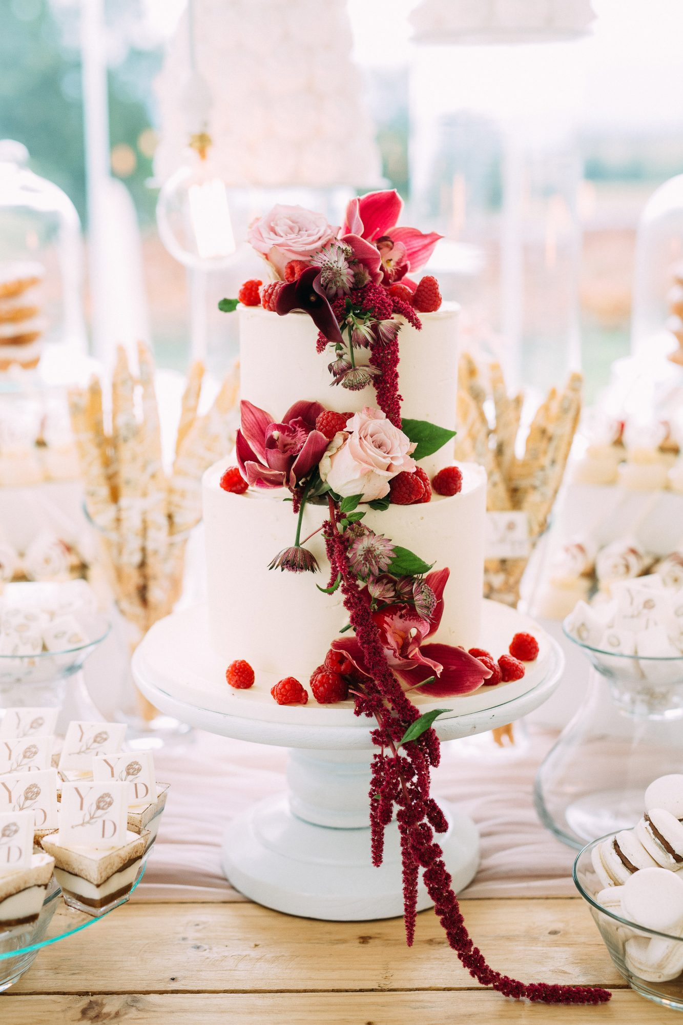 yolana douglas wedding cake with berries and flowers