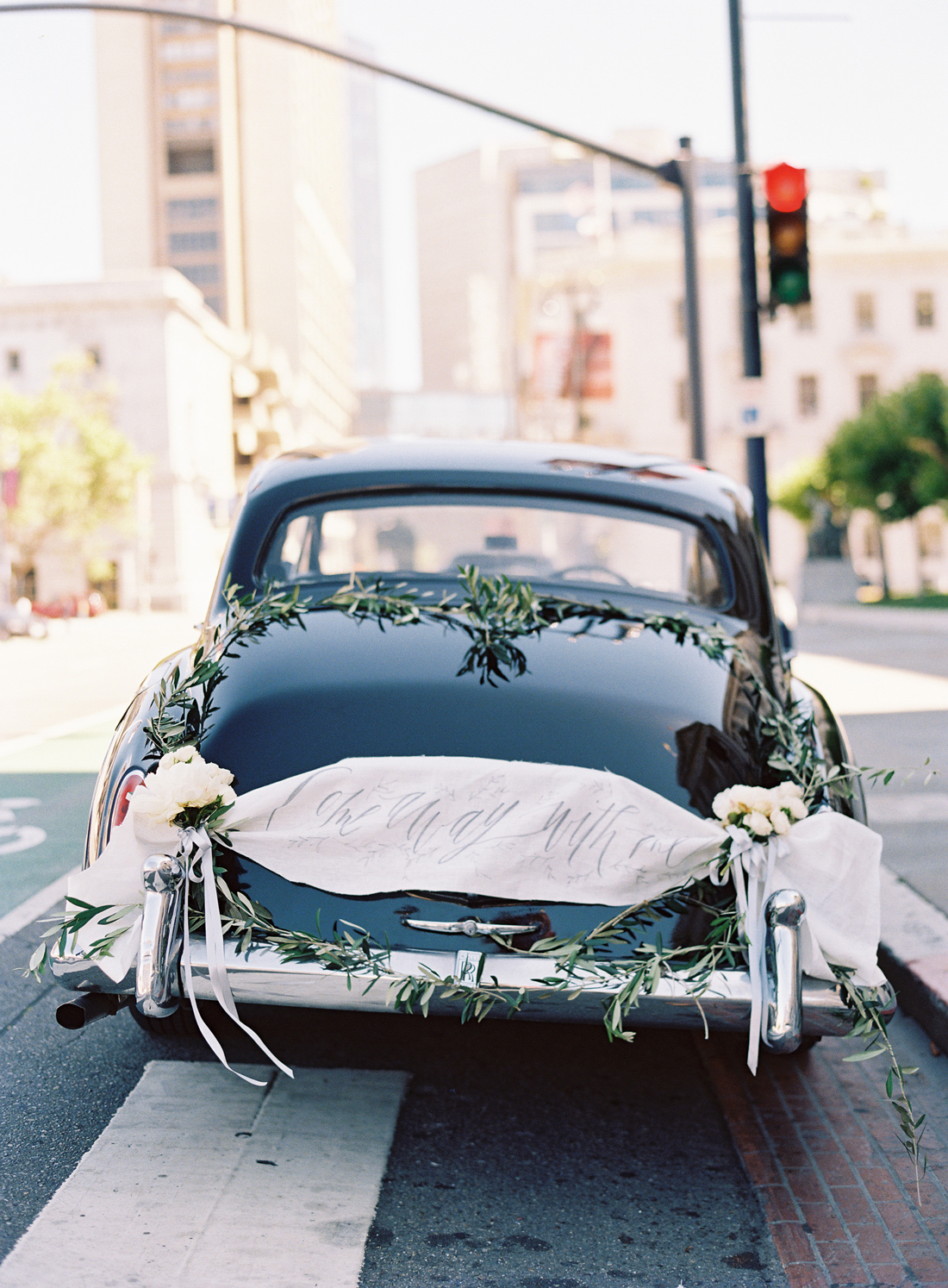 black vintage wedding day getaway car