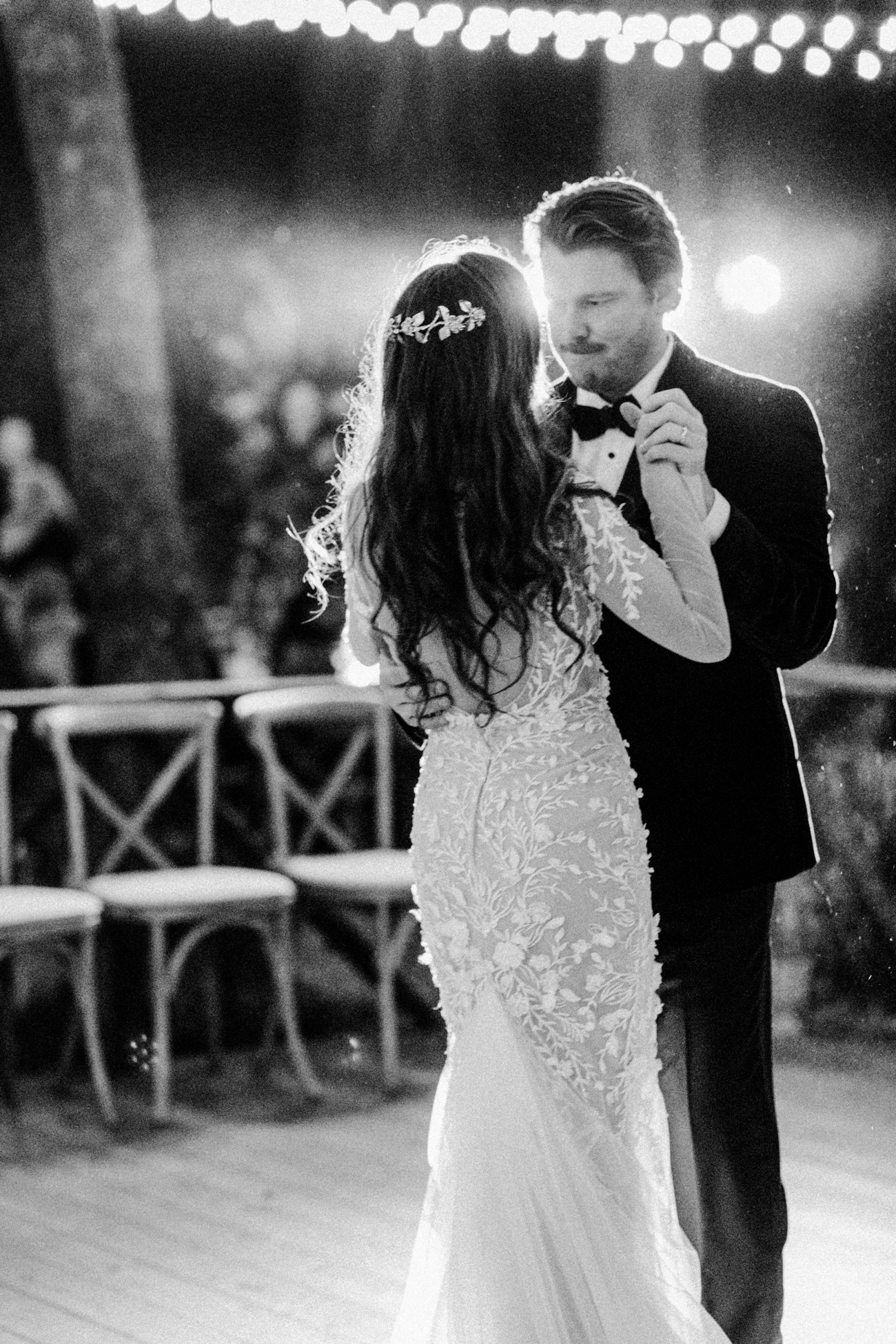 bride and groom hold hands during first dance
