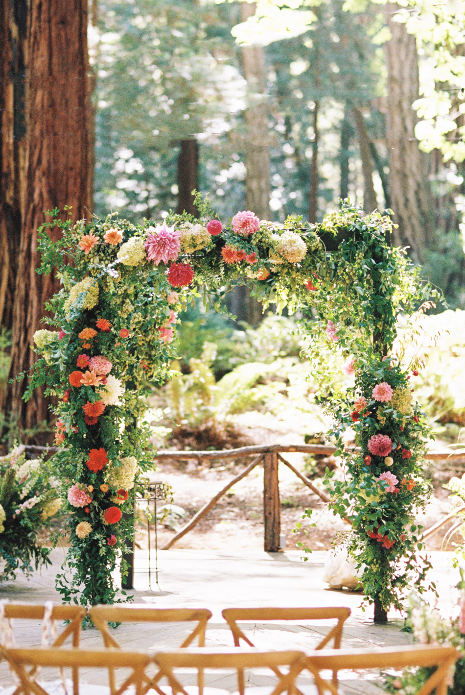 floral wedding ceremony arch in forest