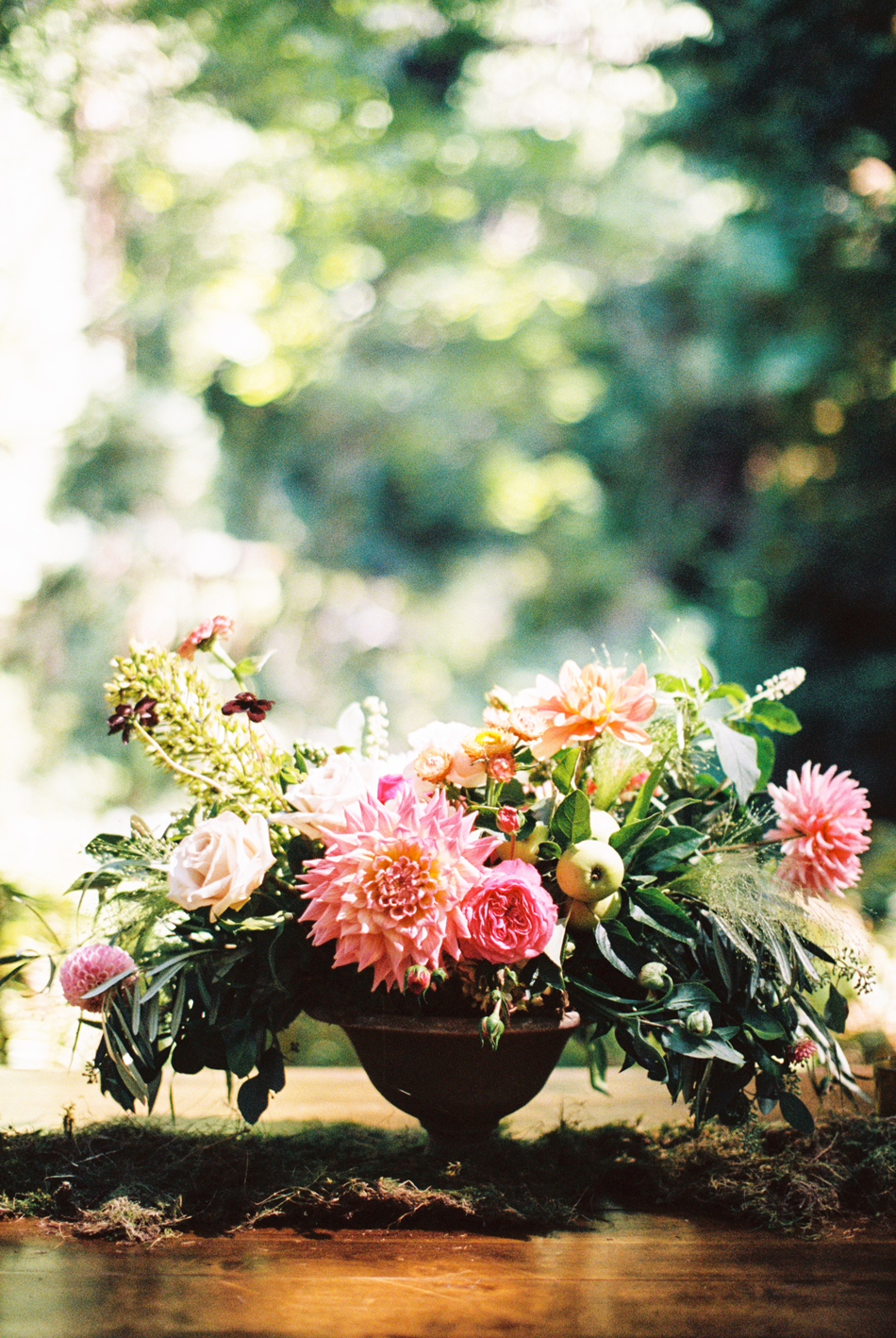 pink and green floral centerpiece with greenery