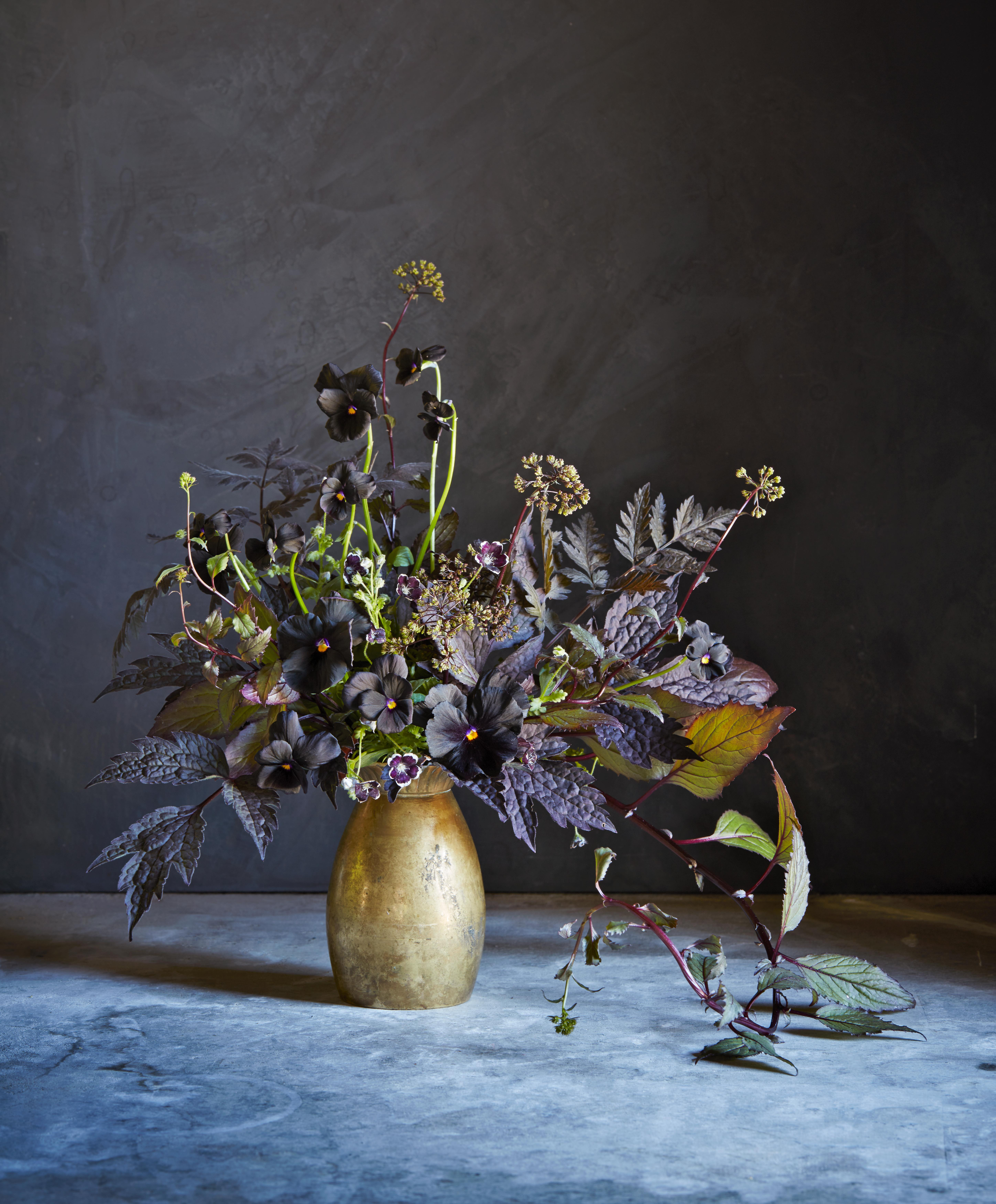 max gill floral arrangement on table