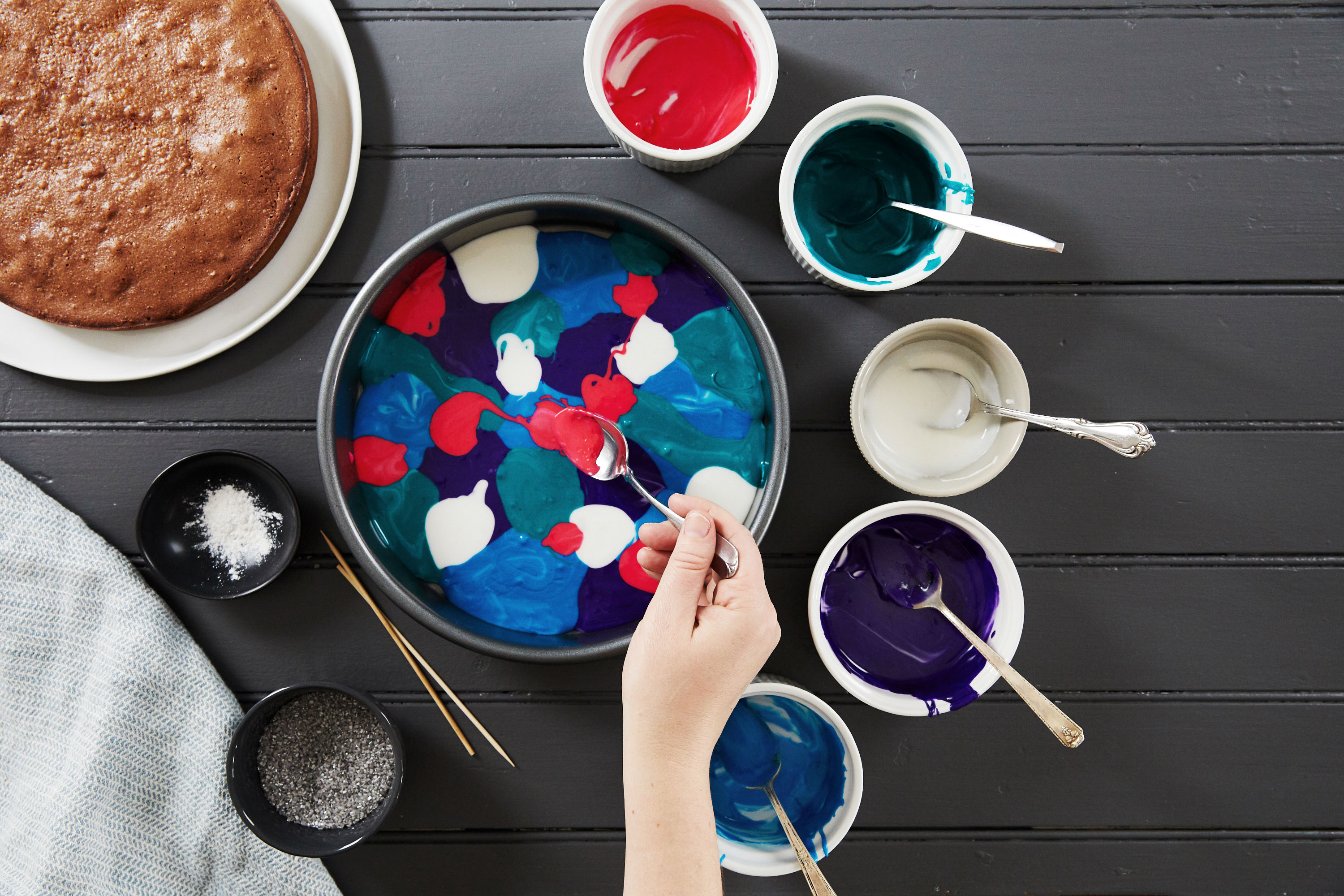 galaxy cake how-to dolloping colored frosting