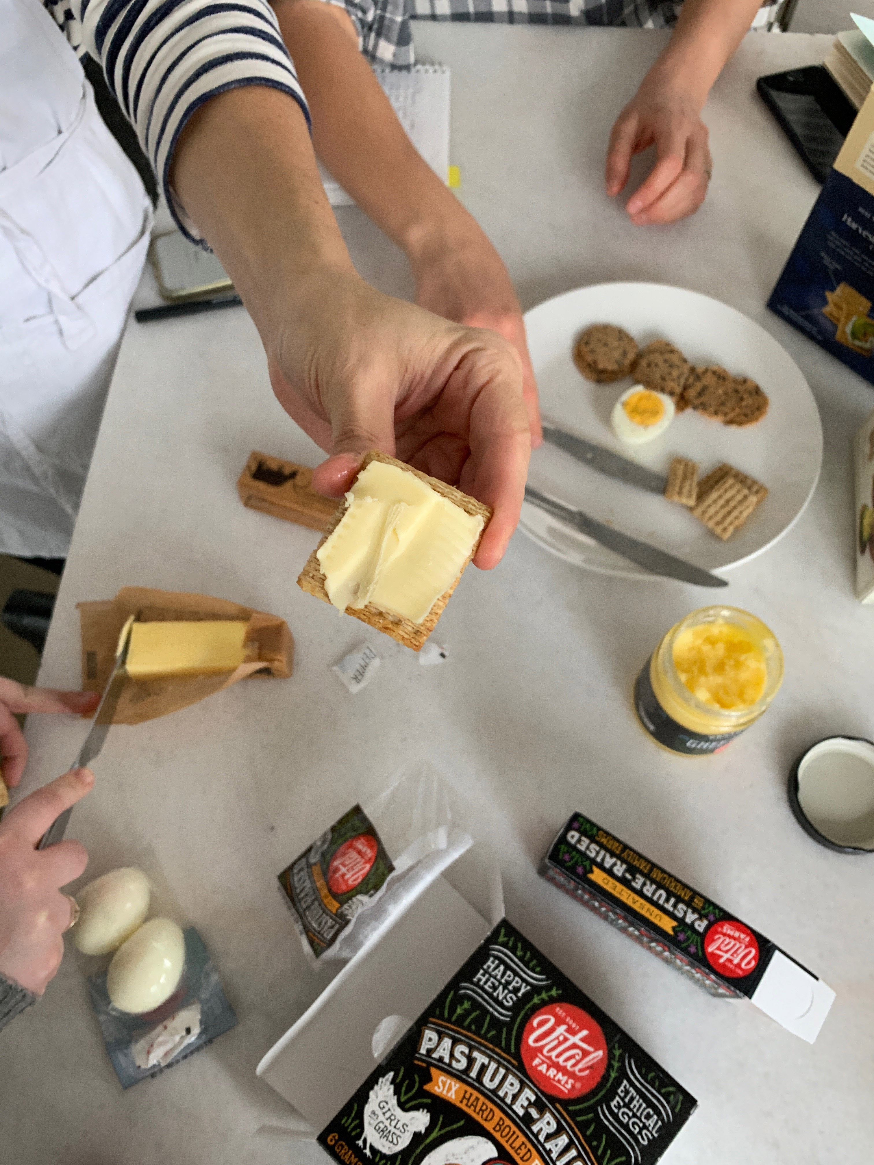 spreading butter on crackers