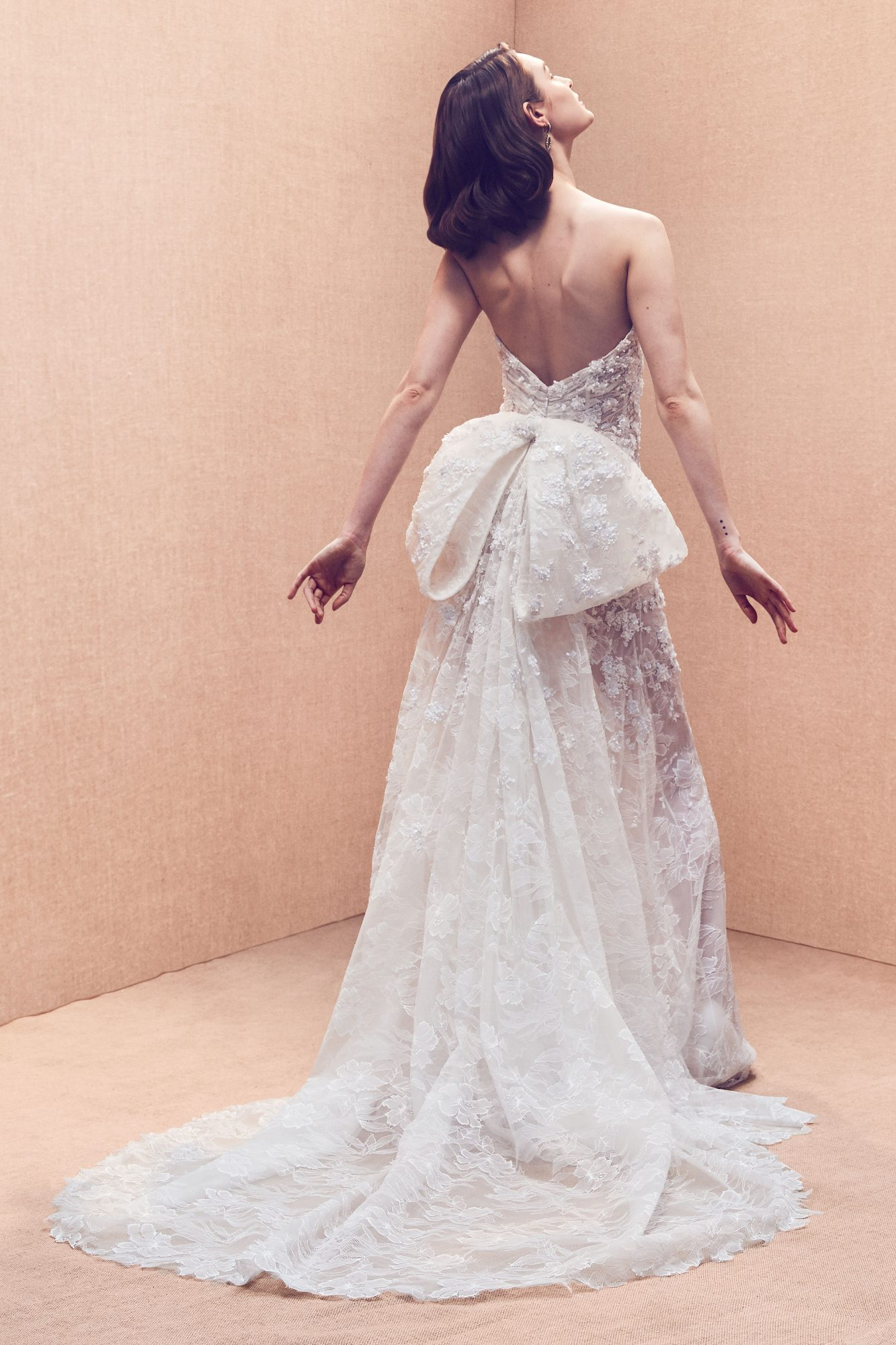 strapless open back large bow train lace floral applique glitter a-line wedding dress Oscar de la Renta Spring 2020