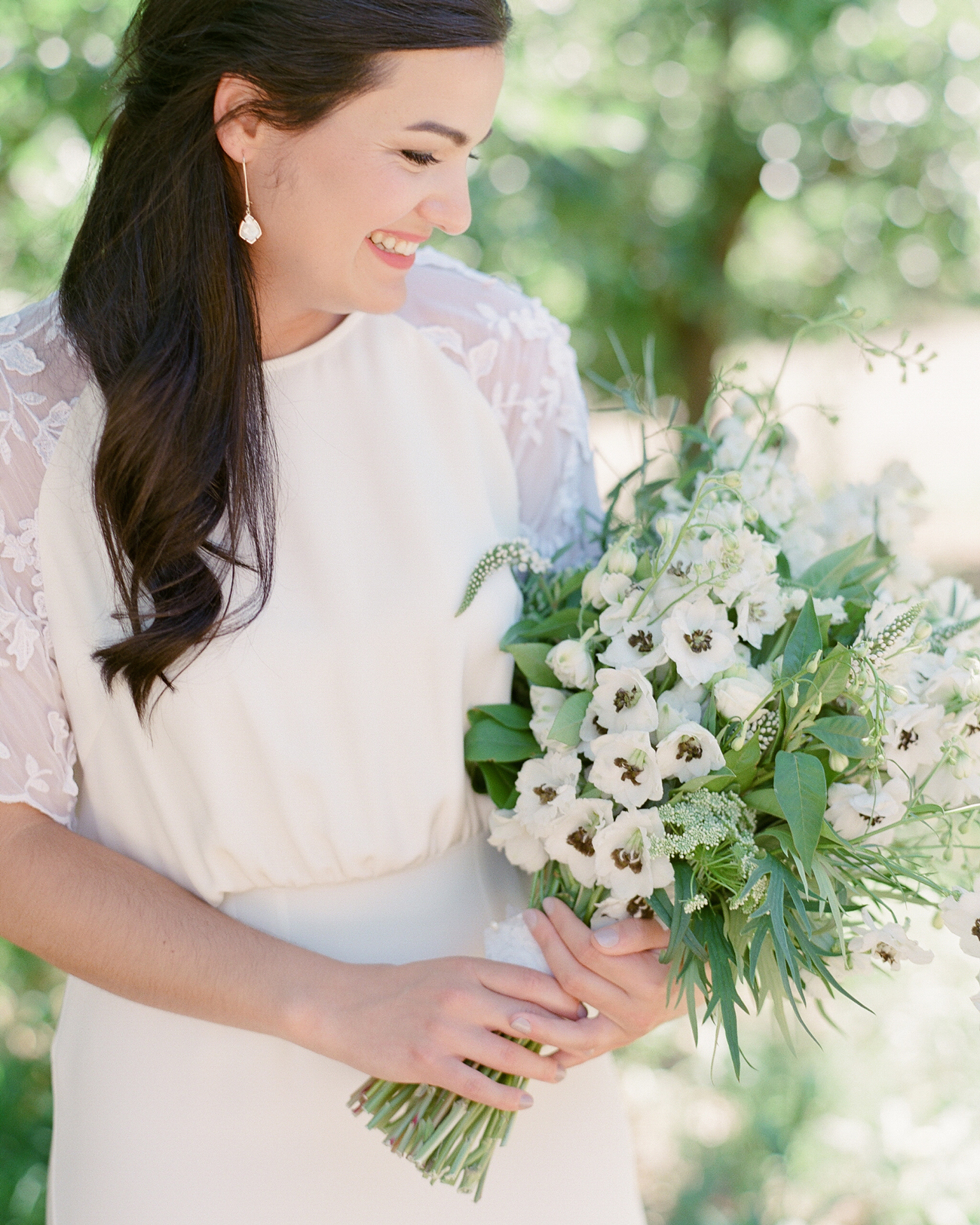 black and white flower long stemmed wedding bouquet with greenery