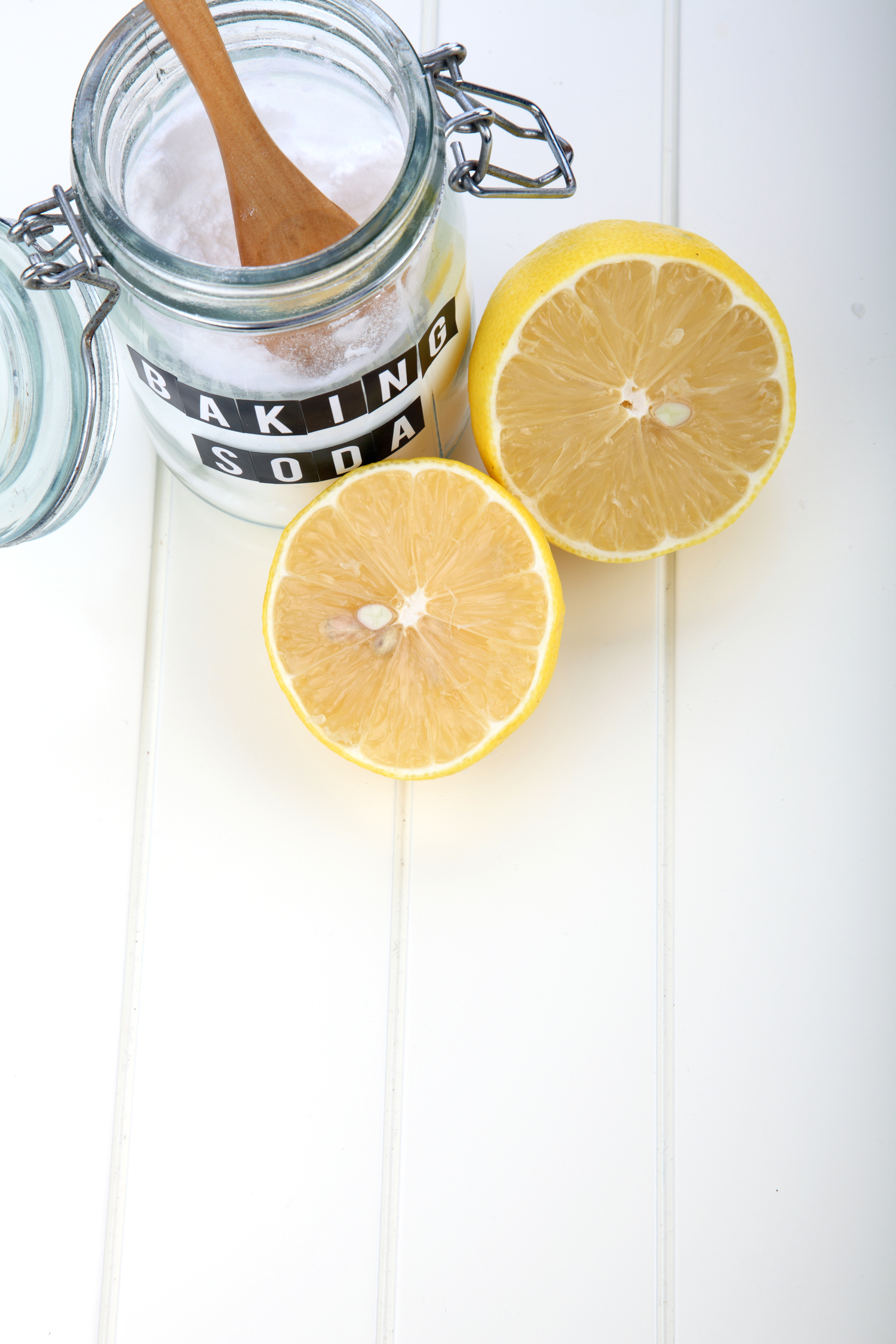 jar of baking soda and a sliced lemon