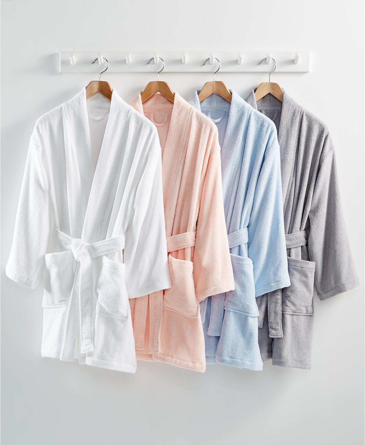 four hanging cotton bathrobes