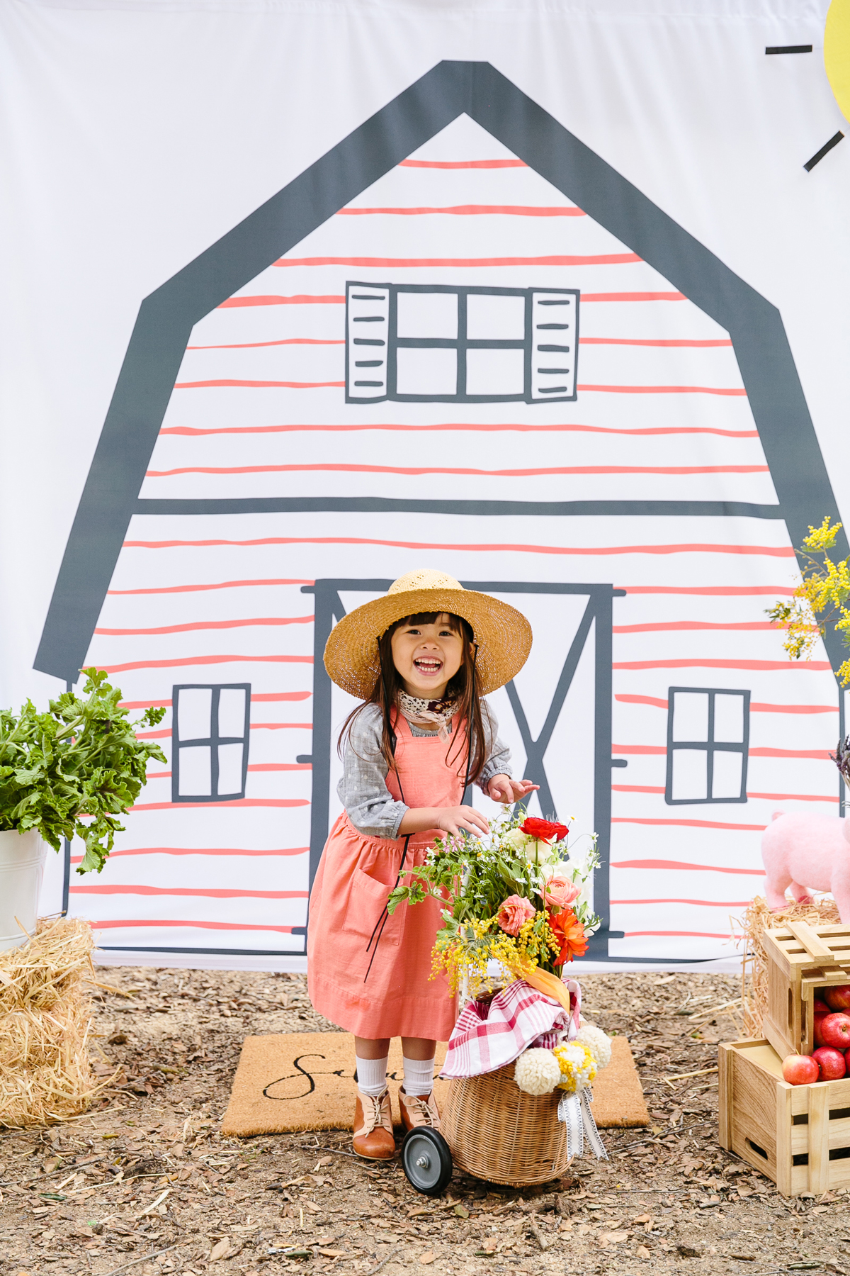 charlottes web childrens party girl wearing straw hat posing in front of photo booth