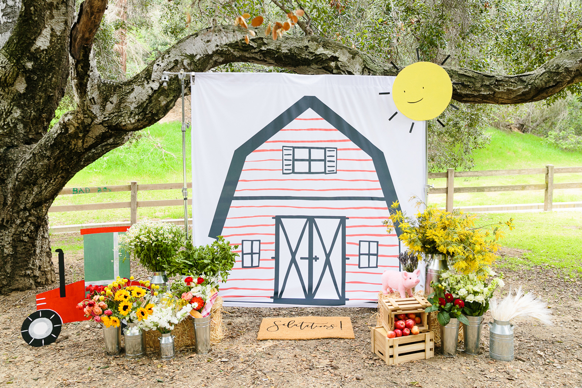 charlottes web childrens party outdoor photo booth with barn illustration backdrop