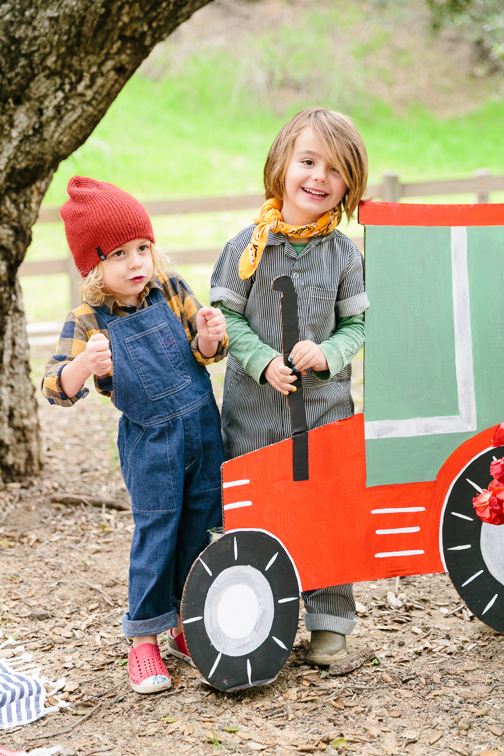 charlottes web childrens party children posing with cardboard tractor