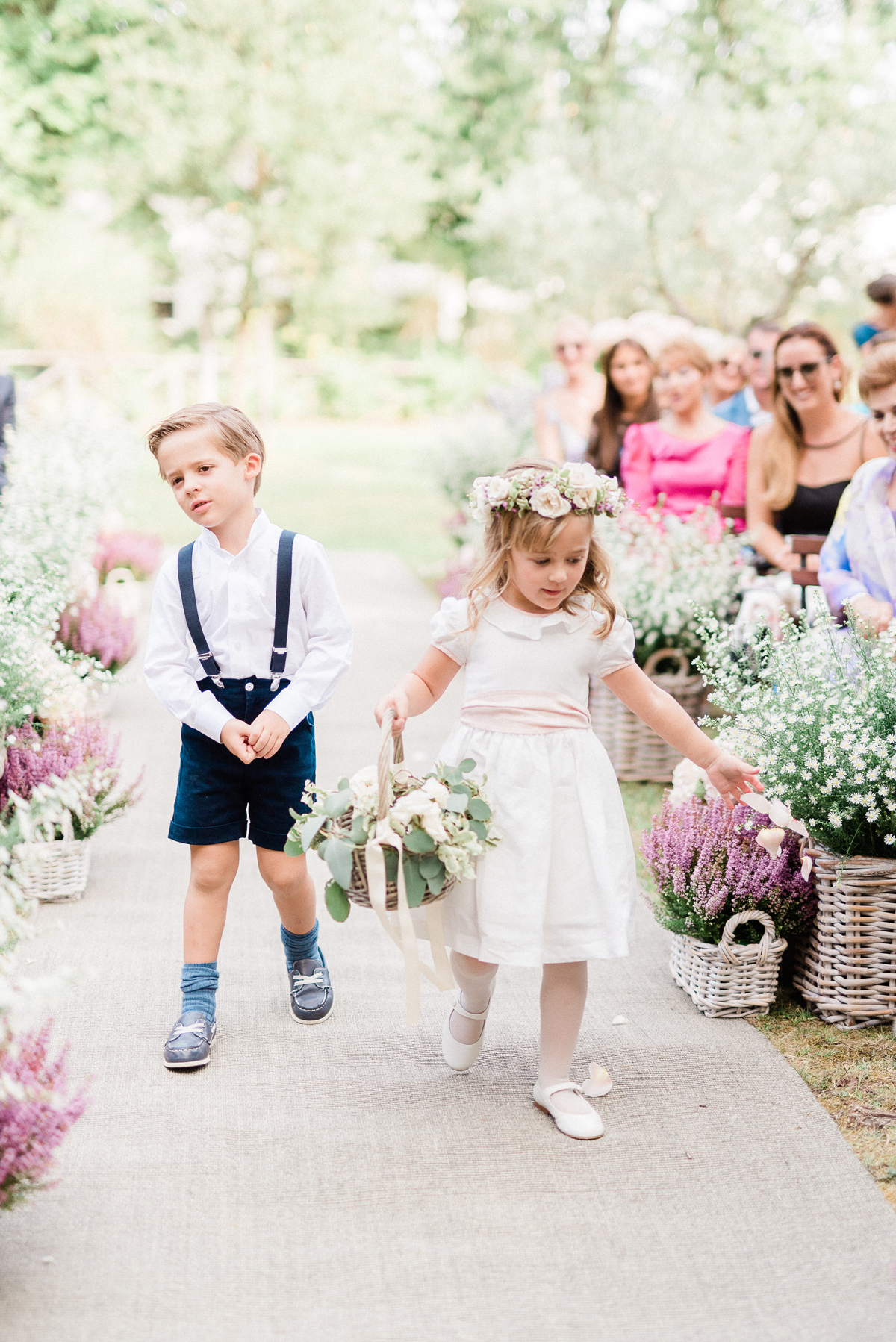 flower girl and ring bearer walking down processional wedding aisle