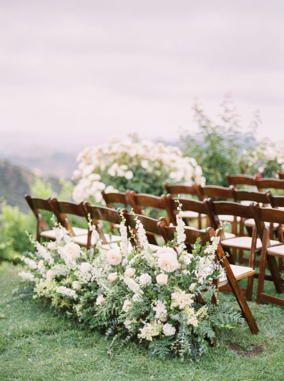 last row ceremony chair decorations large white blooms and greenery floral arrangements