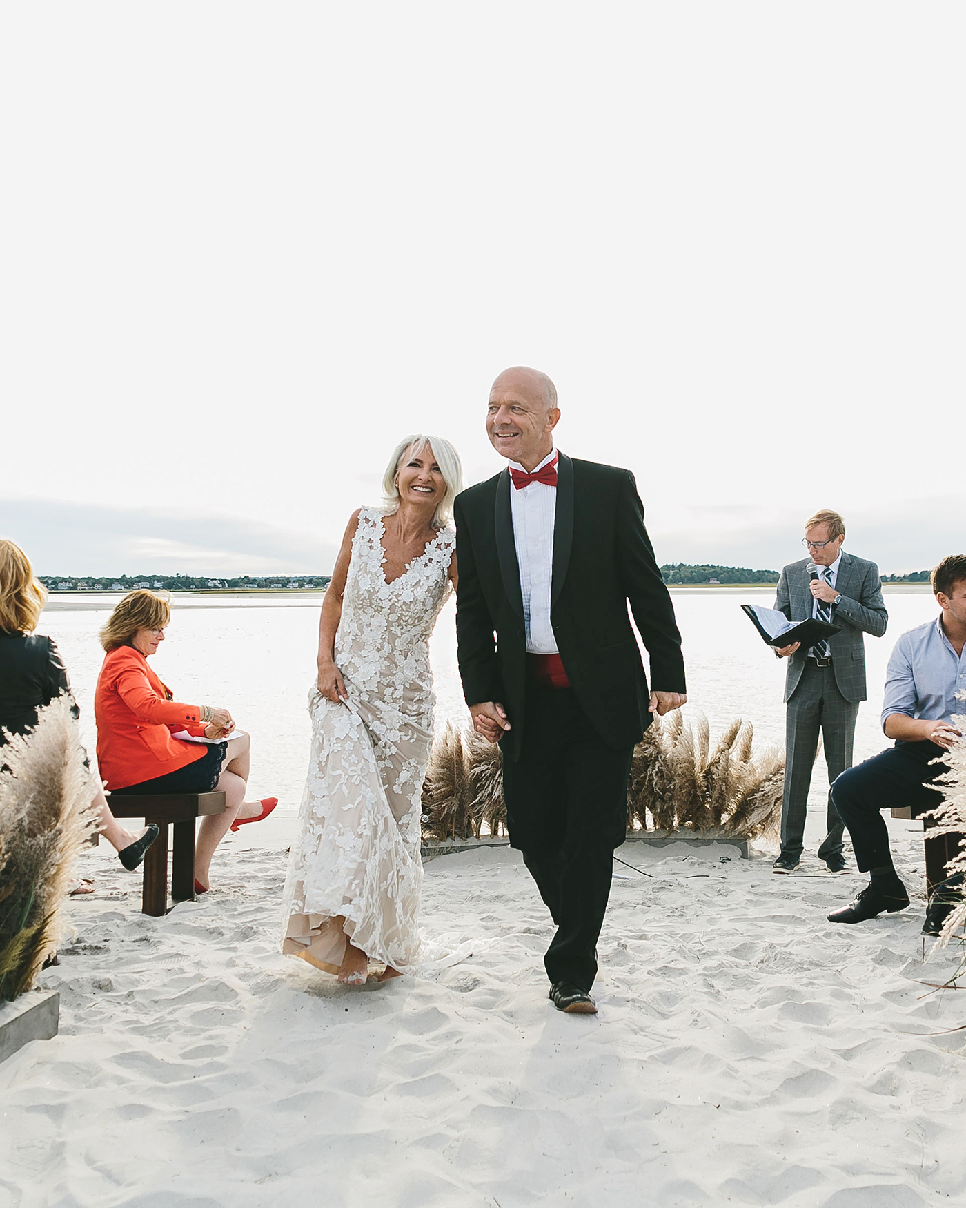 bride and groom beach recessional