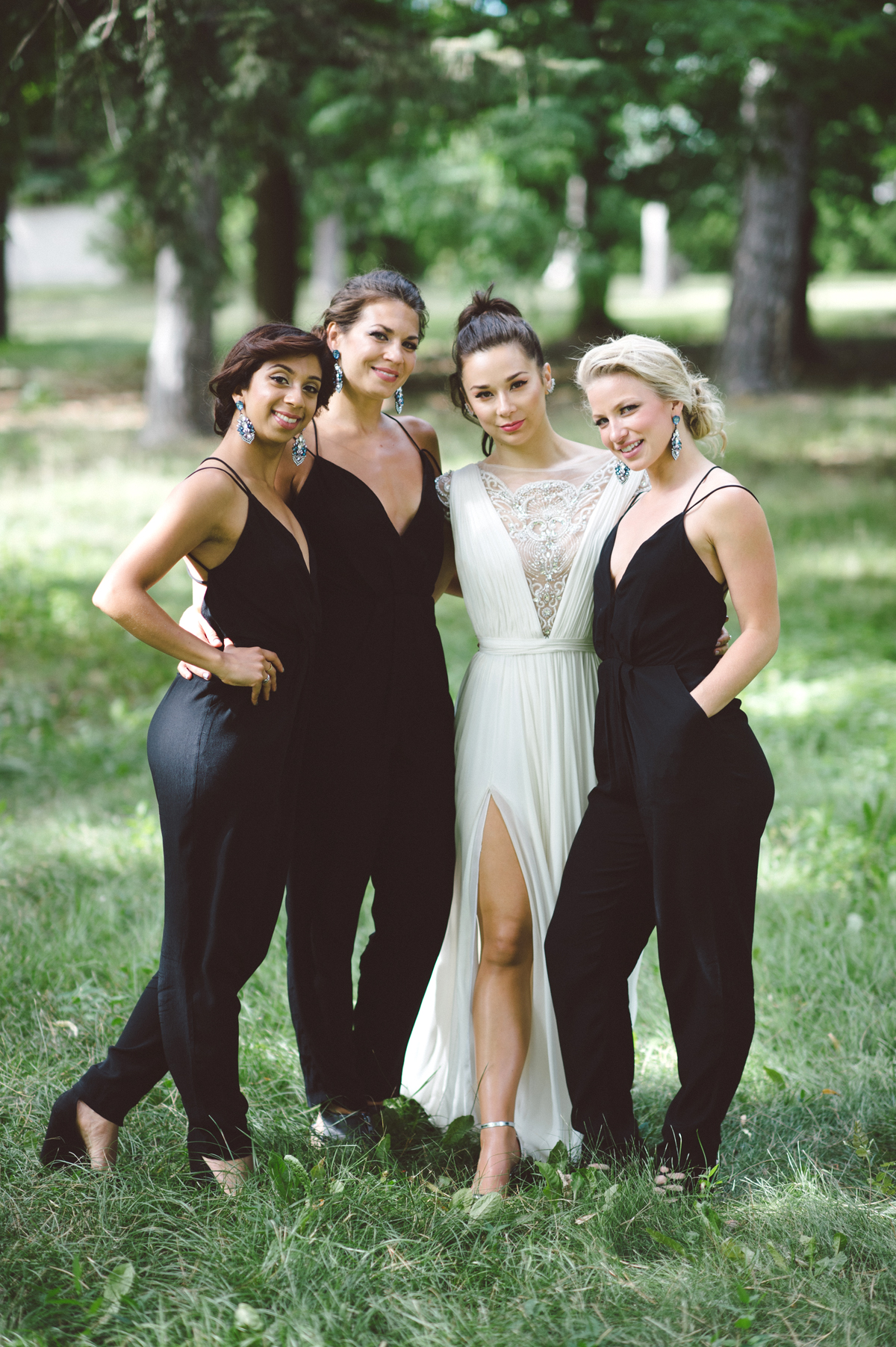 women wearing black spaghetti strap bridesmaids jumpsuits