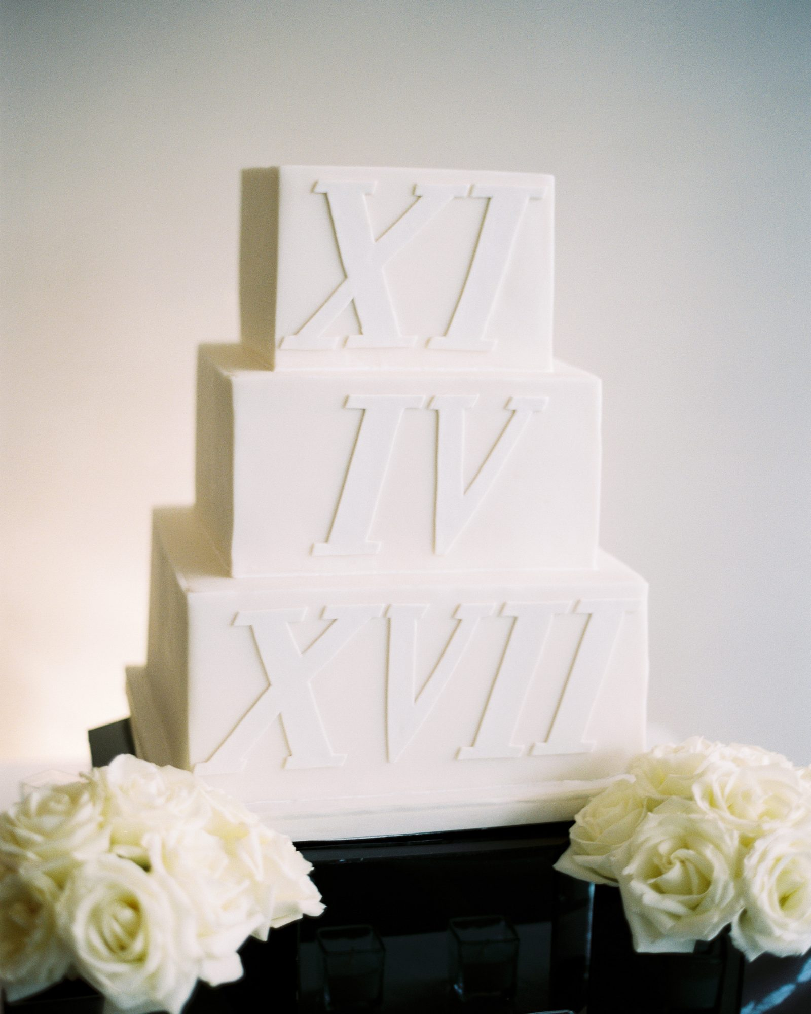cubed wedding cake with roman numerals