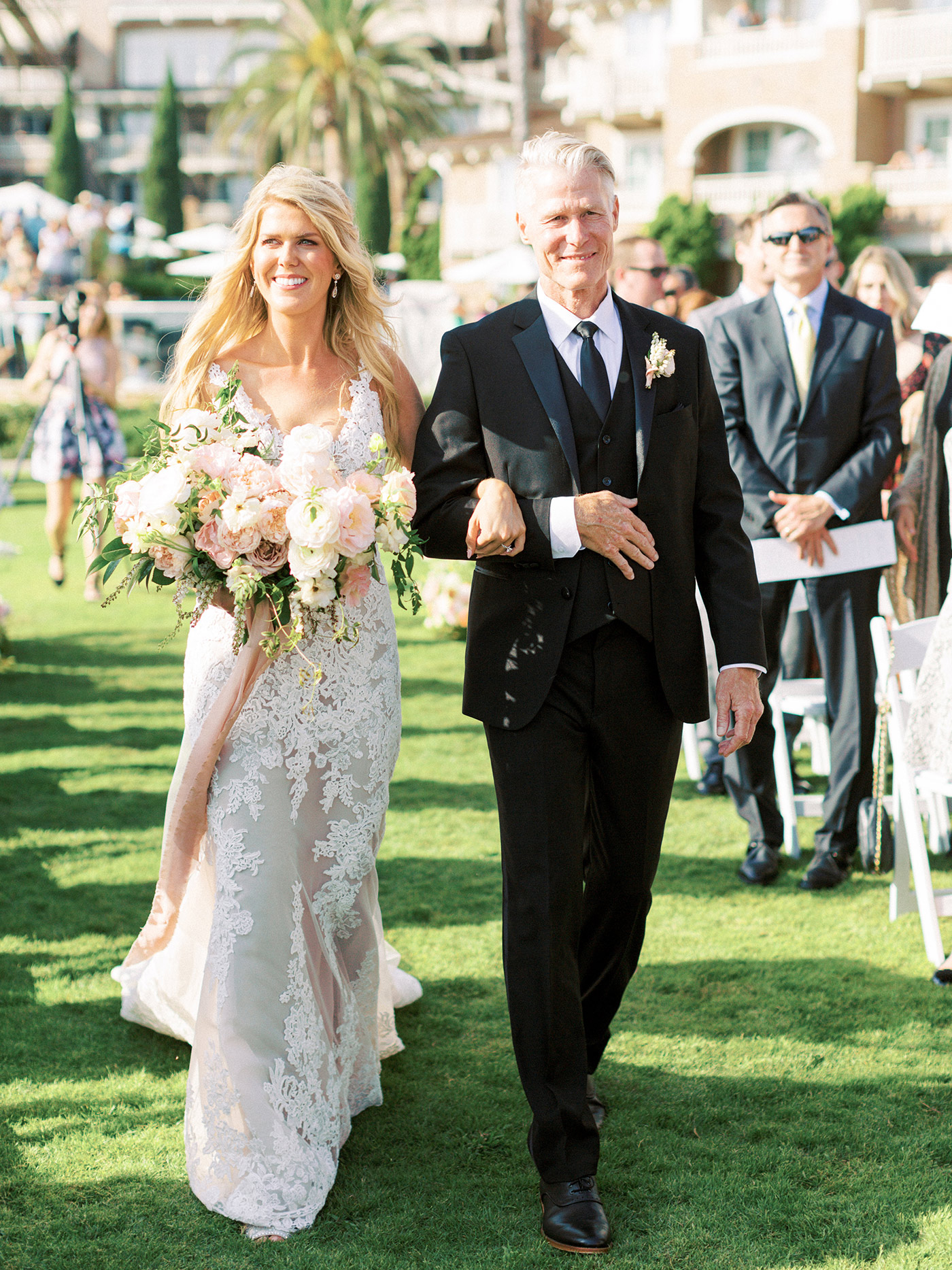 mykaela and brendon wedding bride walking down aisle with father