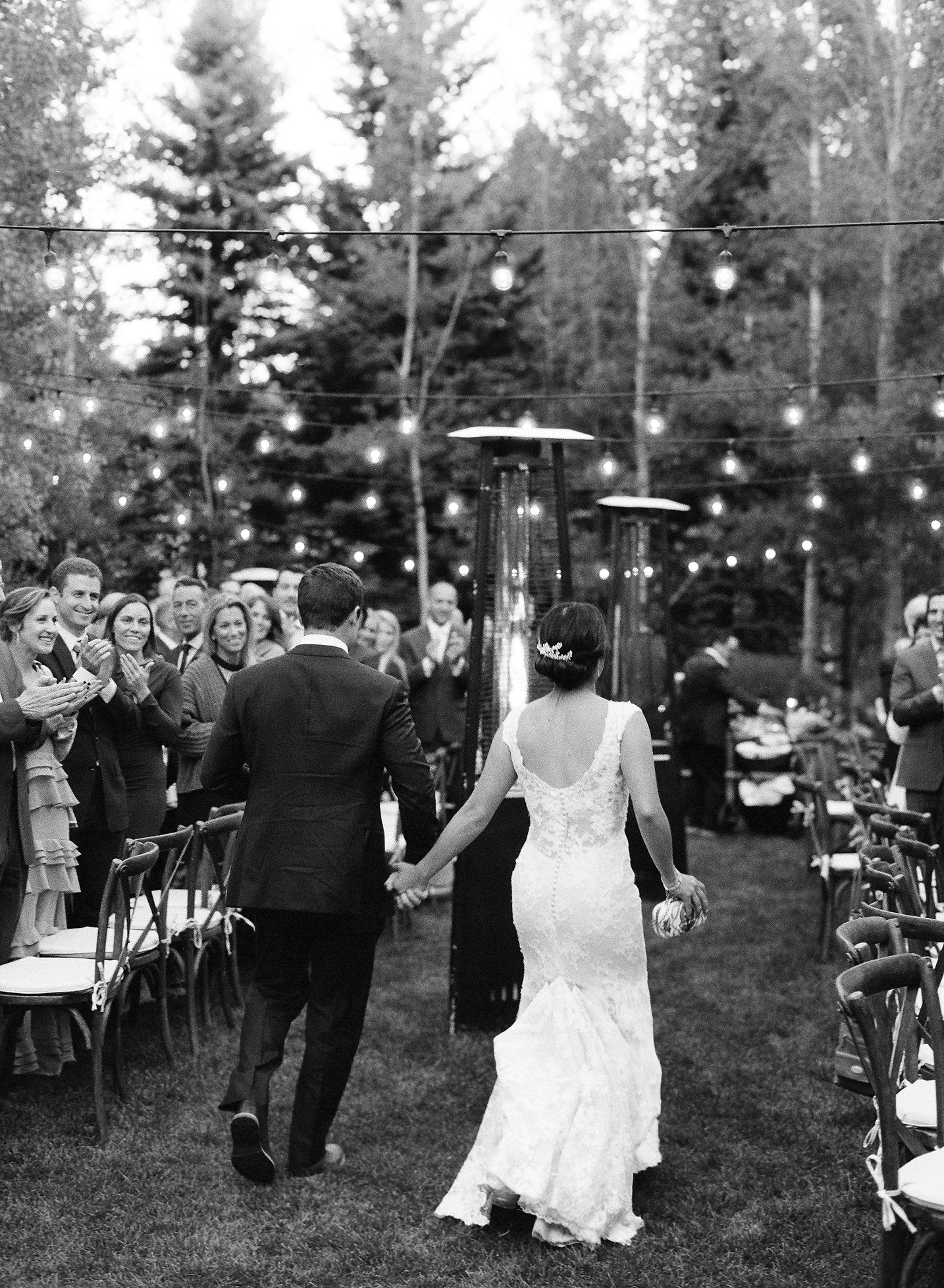 bride and groom holding hands walking into wedding reception