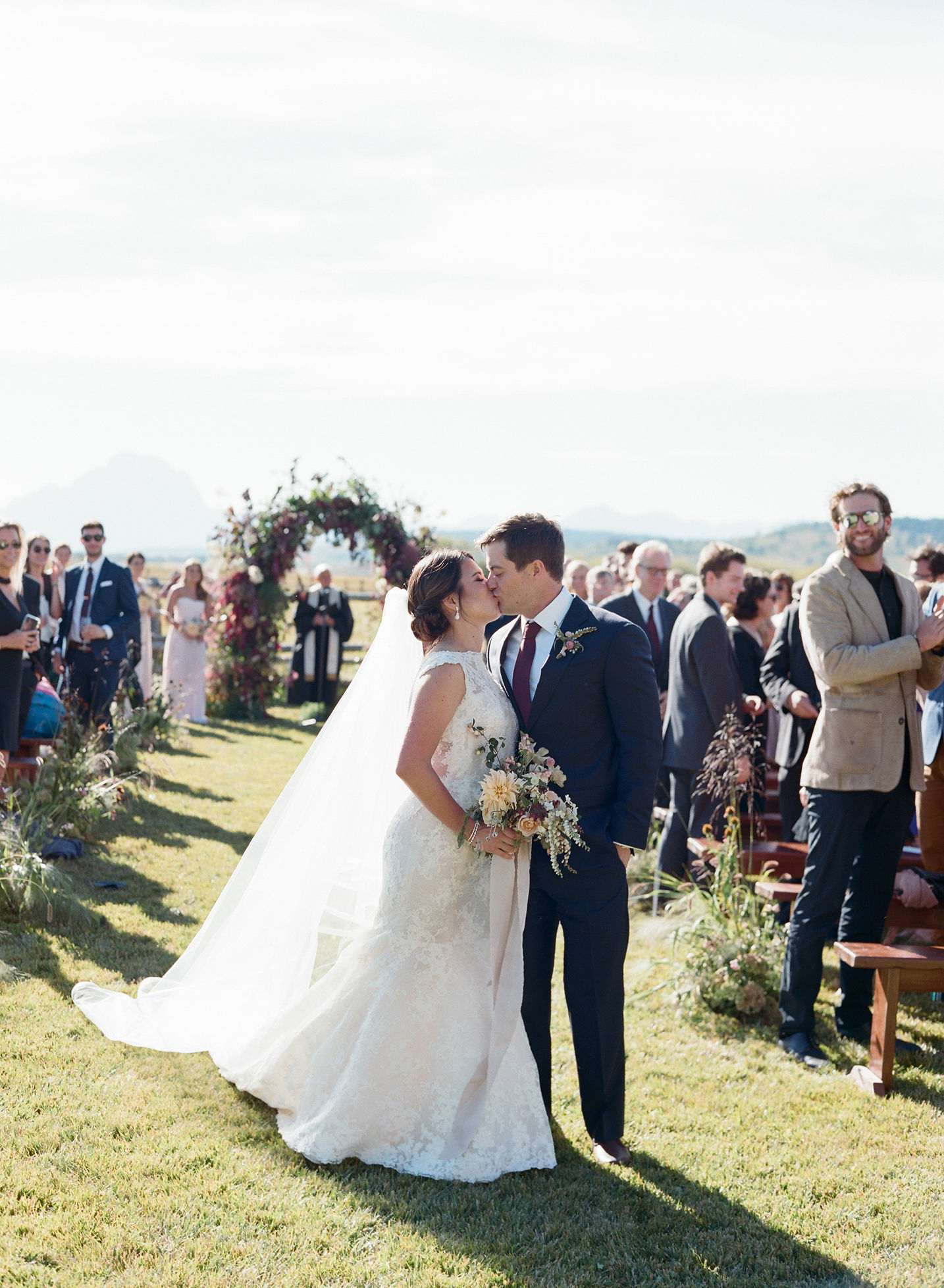 bride and groom kissing after wedding ceremony
