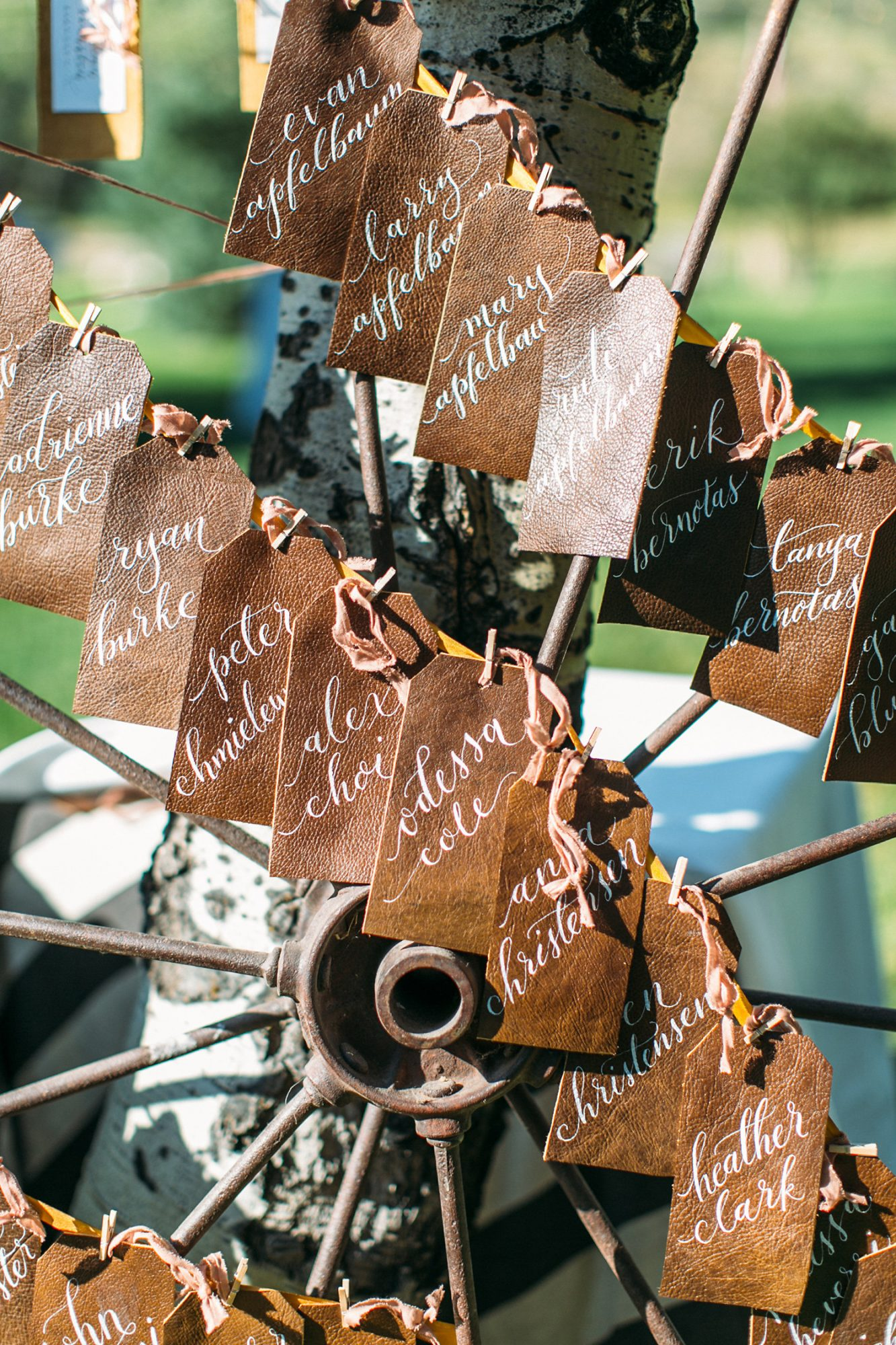 leather wedding ideas seating chart tags on farm wheel