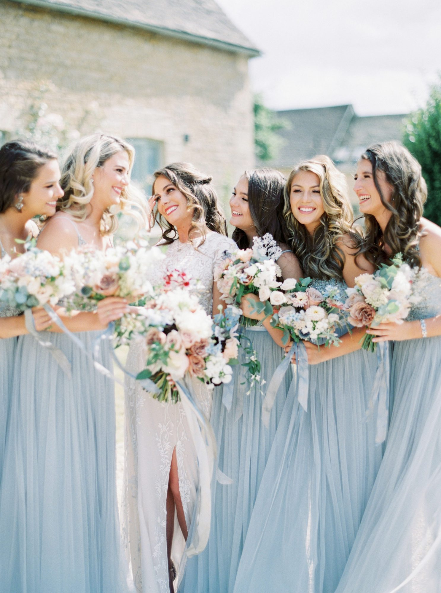 bridesmaids wearing BHLDN avery dresses with sequin bodice and tulle skirts