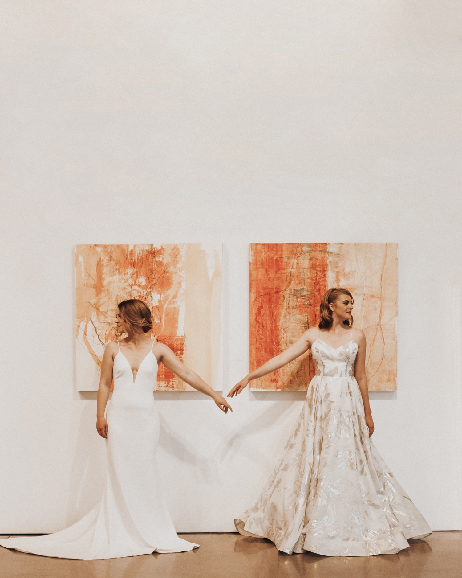 art-inspired wedding ideas brides posing in front of paintings in gallery