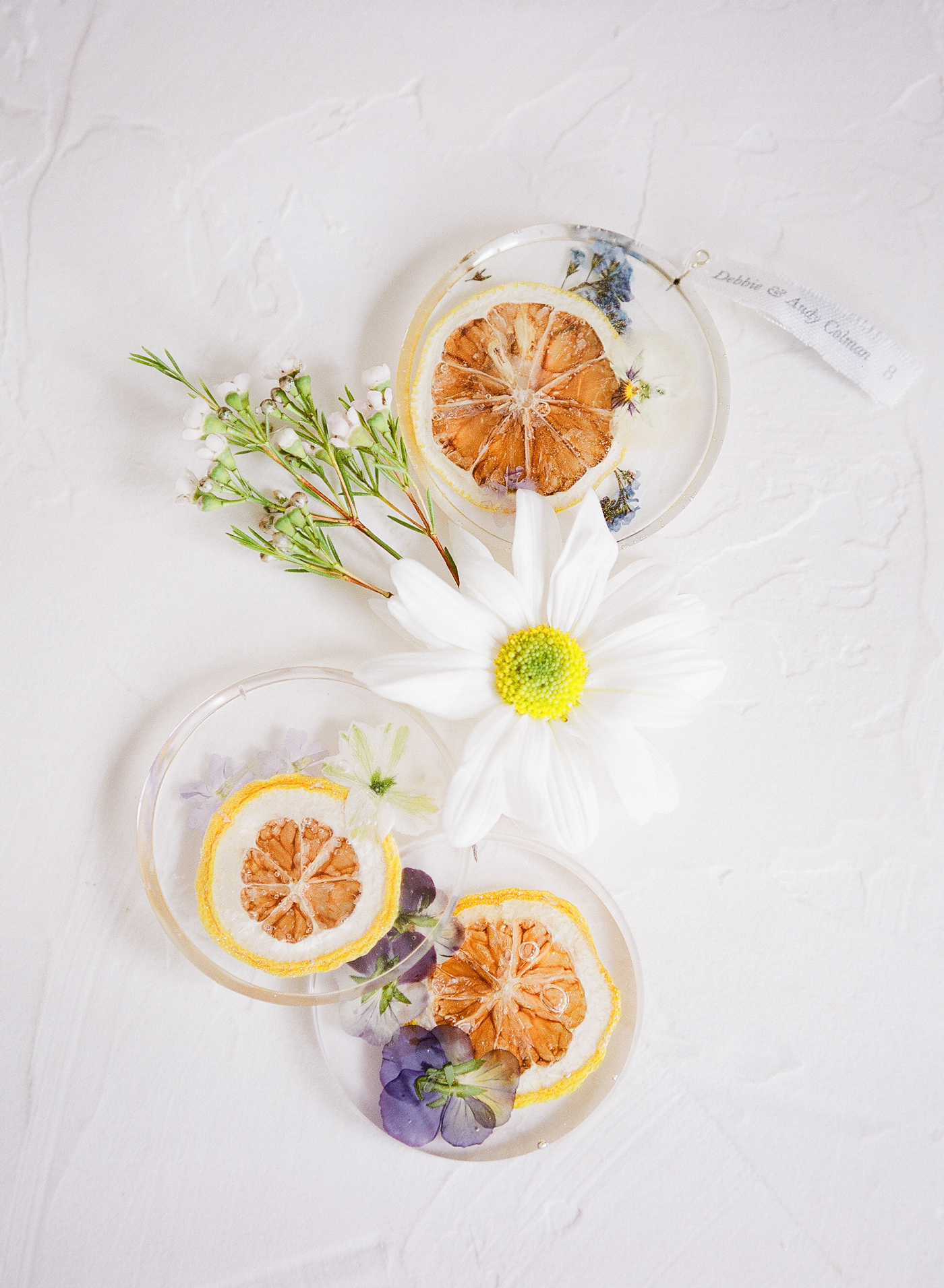dried lemon and floral resin pendants escort cards