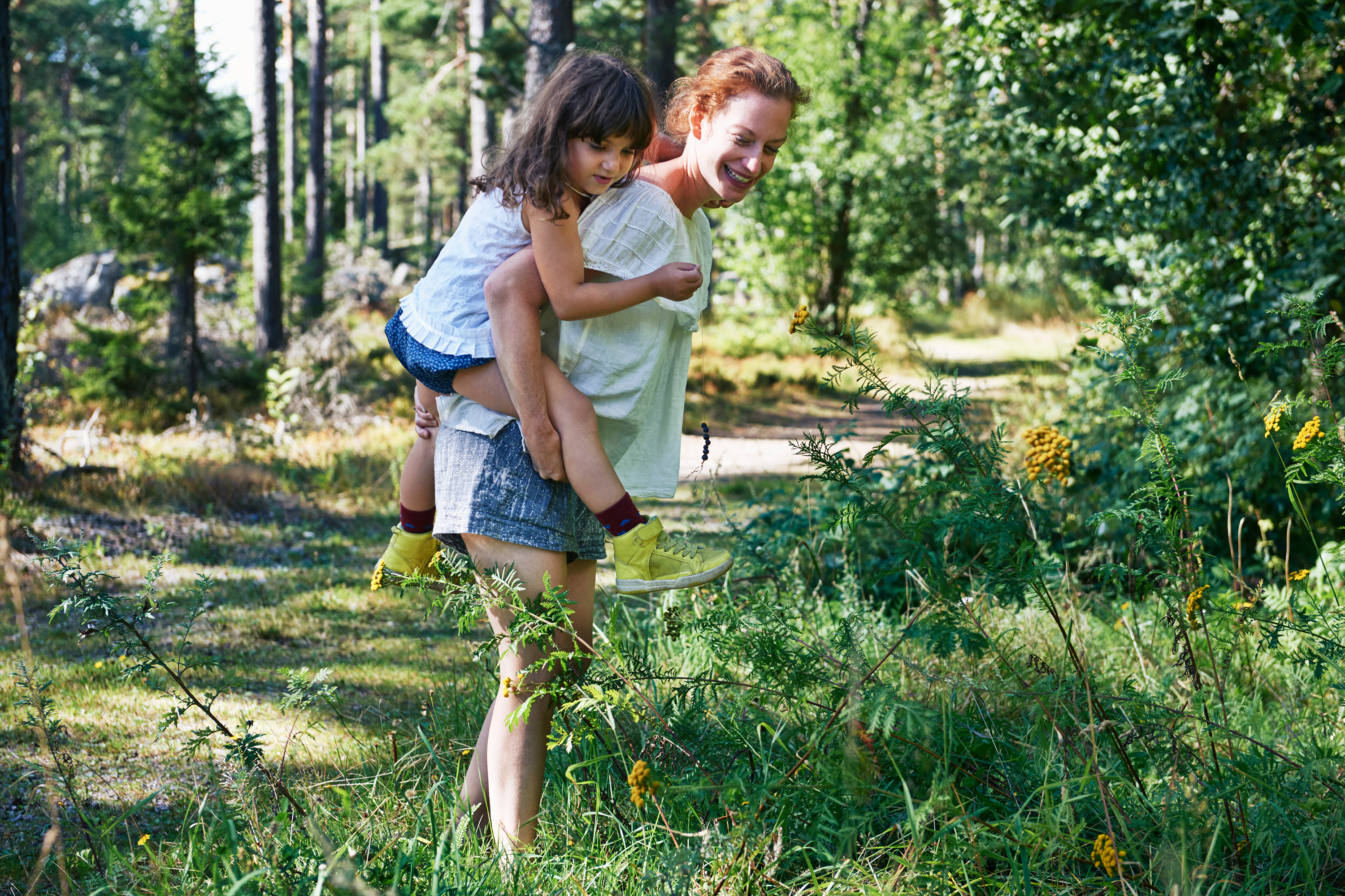 Mother and Daughter Walking in a Forest
