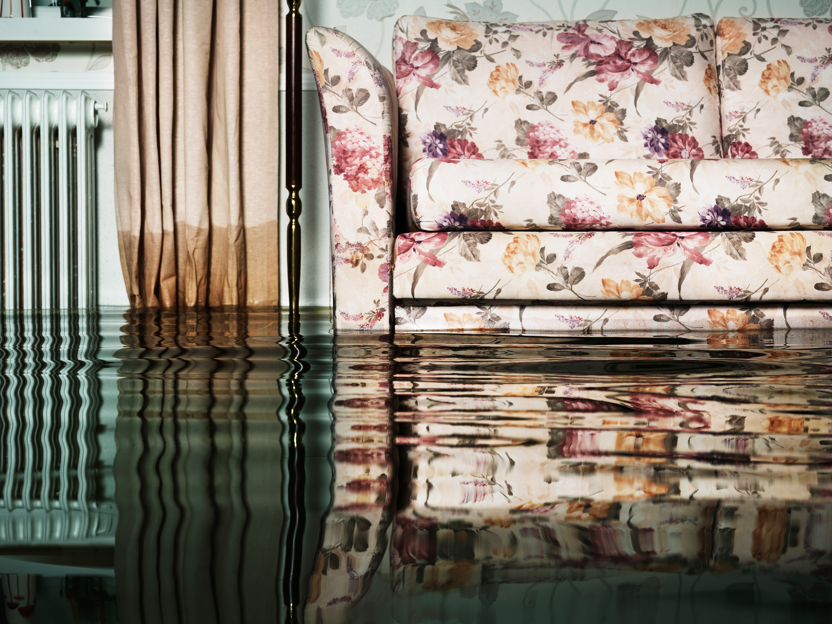 living room in flooded home with water