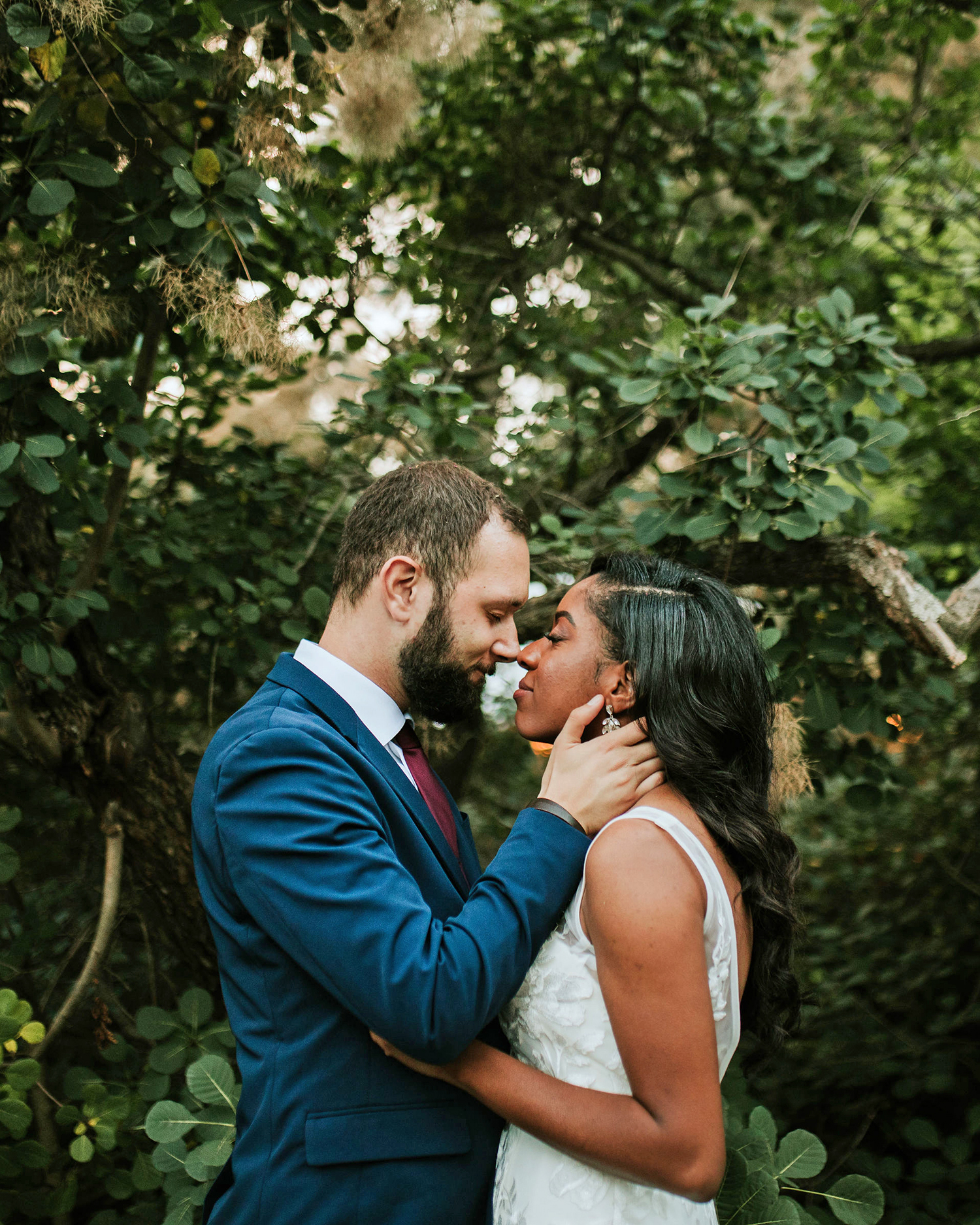 ferbie rob boho wedding couple in forest kiss