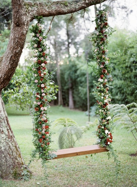 red and white floral covered hanging swing