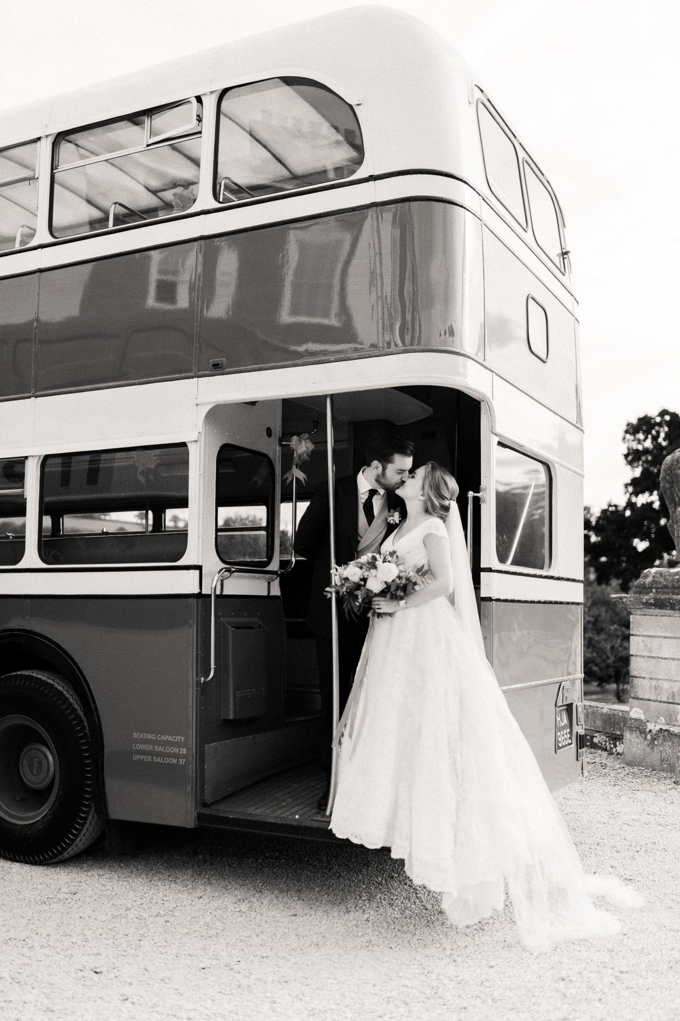 sophie christopher wedding couple on bus in black and white