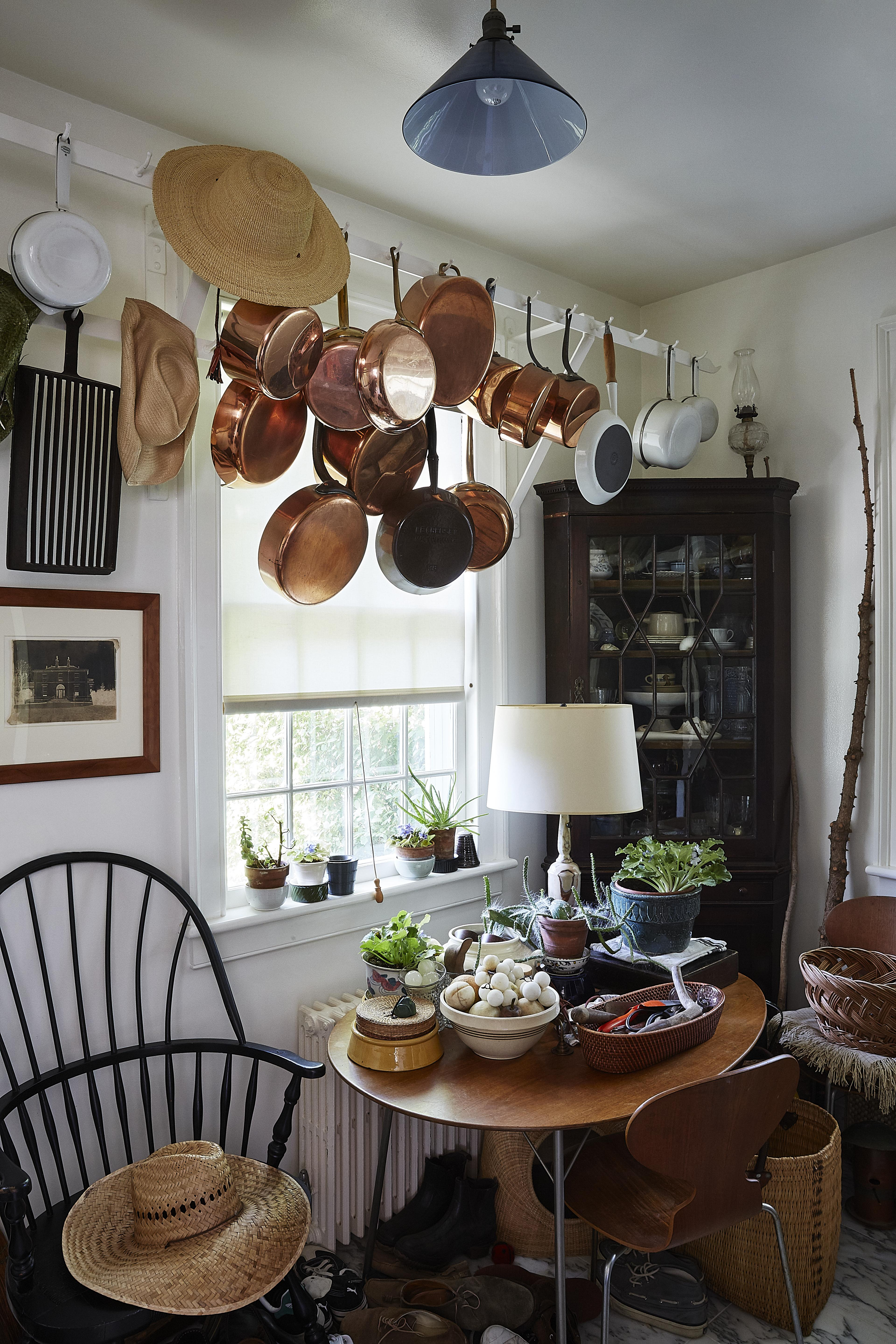long island home hanging pots and straw hat on chair