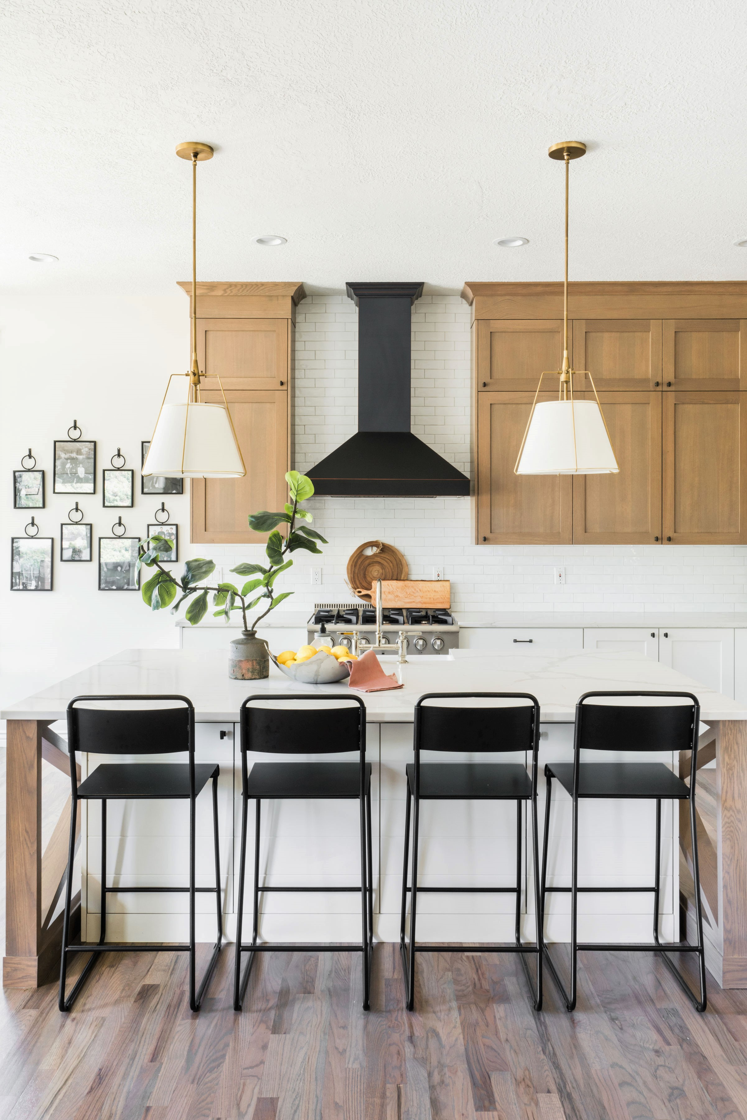 oak point kitchen island with black chairs