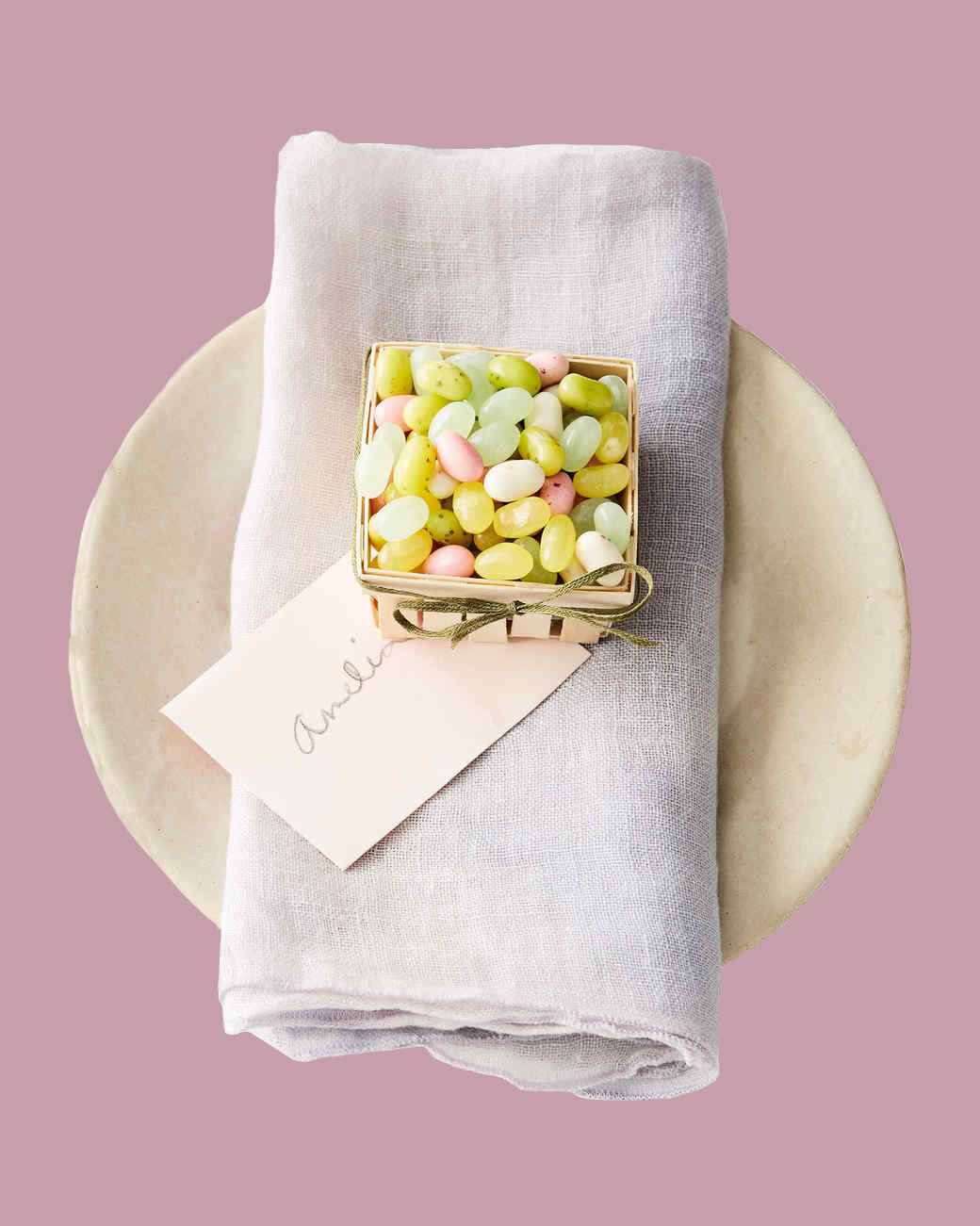 place setting with miniature easter basket of jelly beans