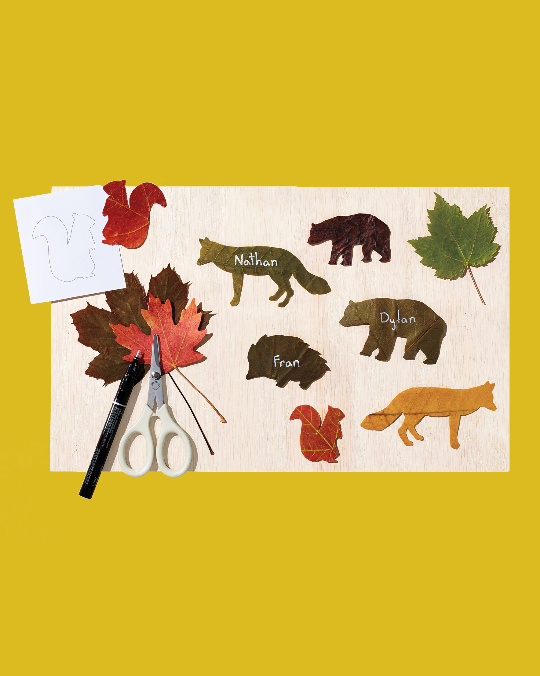 crafting materials and leaf animal place cards