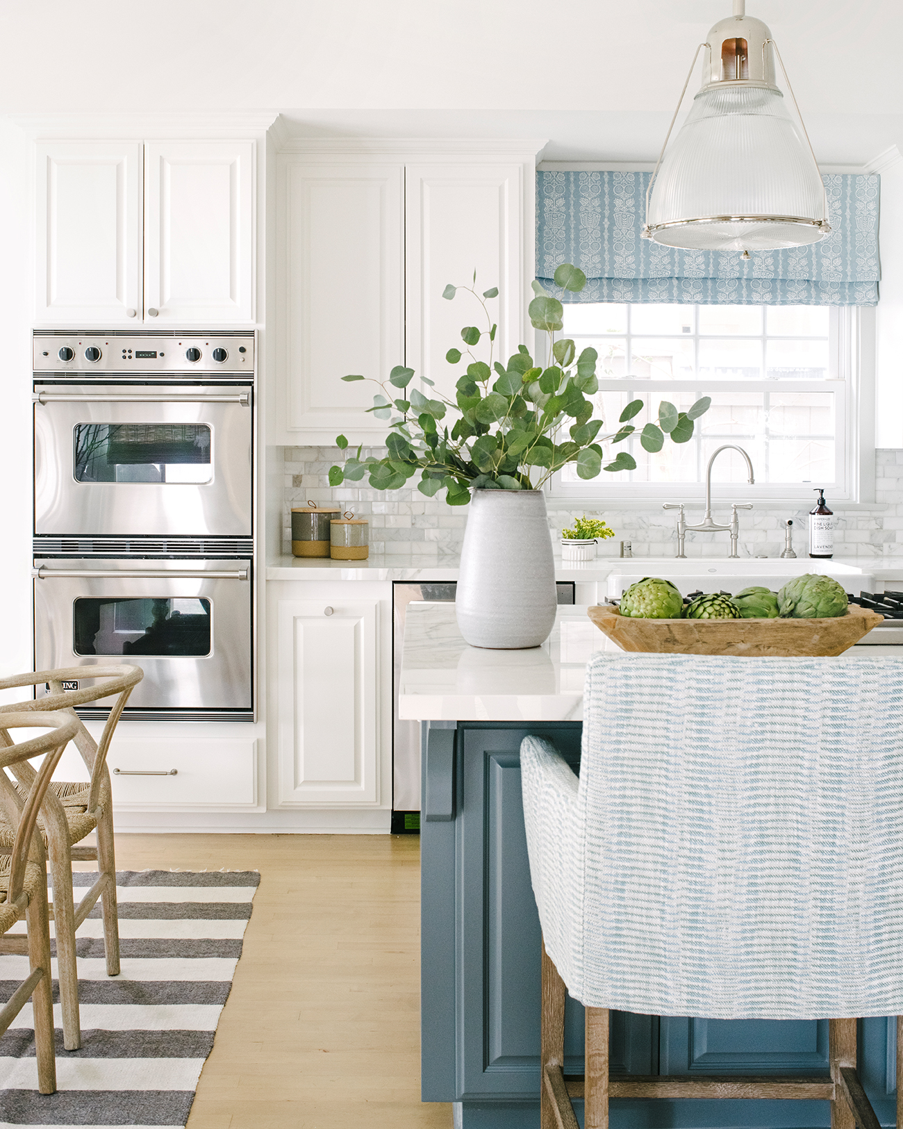 southern california house white and blue kitchen with striped rug