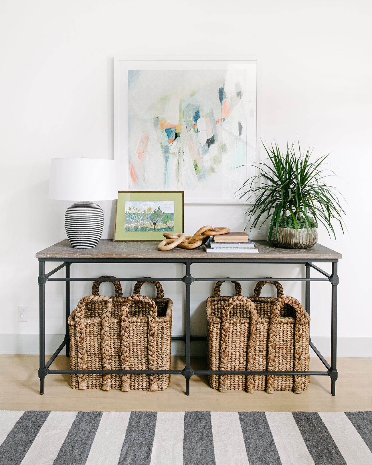 southern california house hallway table with baskets underneath
