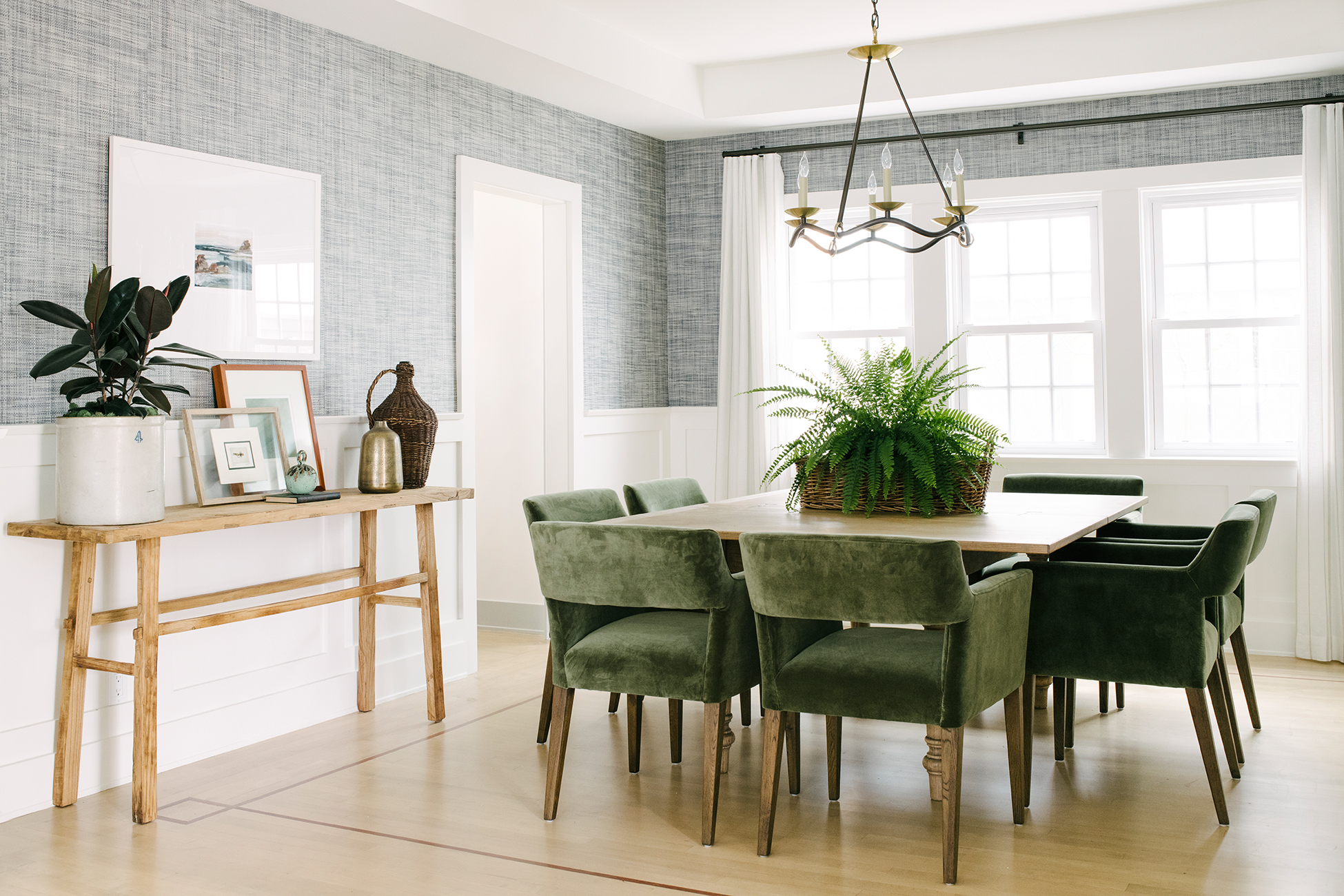 southern california house comfortable dining room with green chairs
