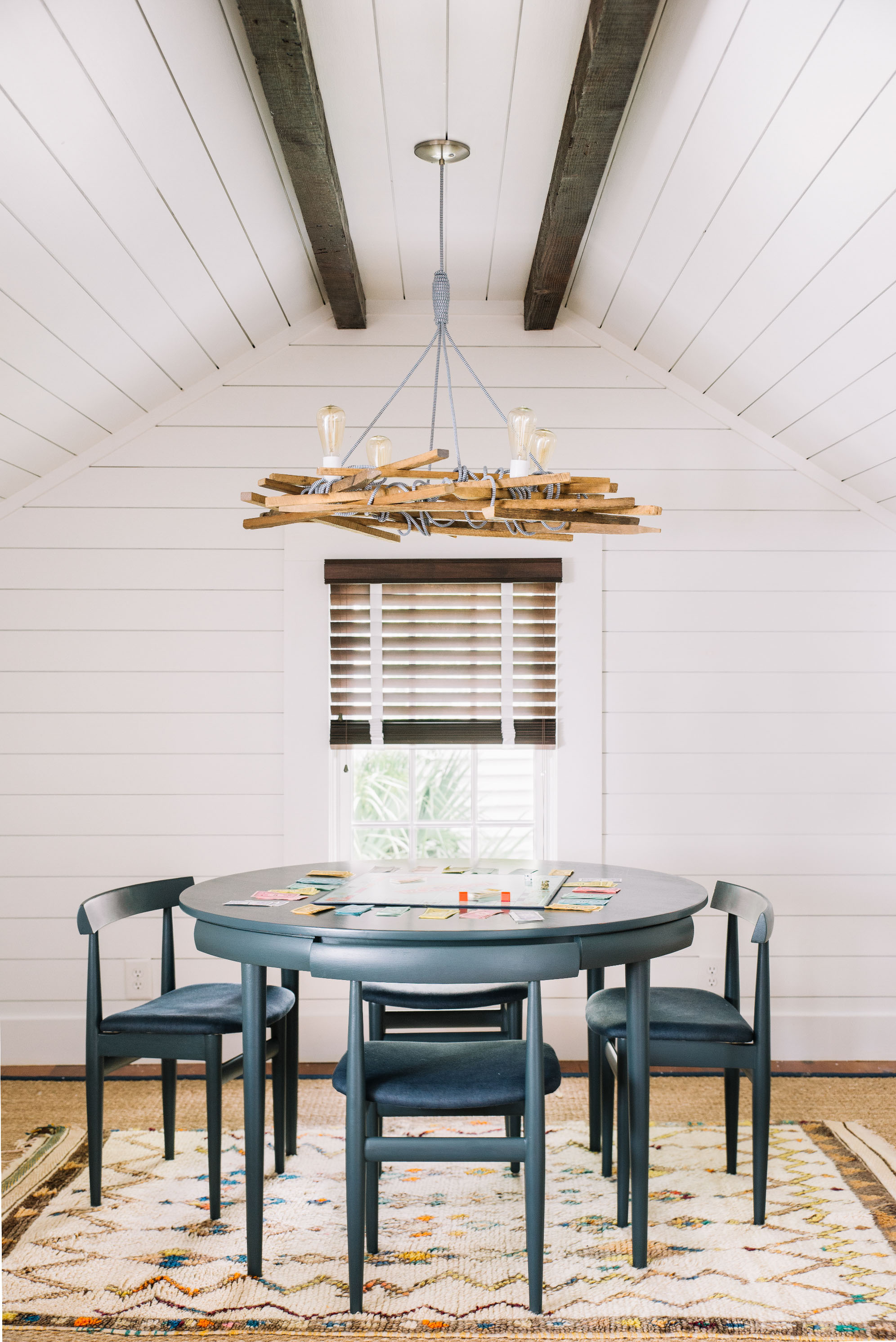 wood and rope chandelier above round table south carolina beach house