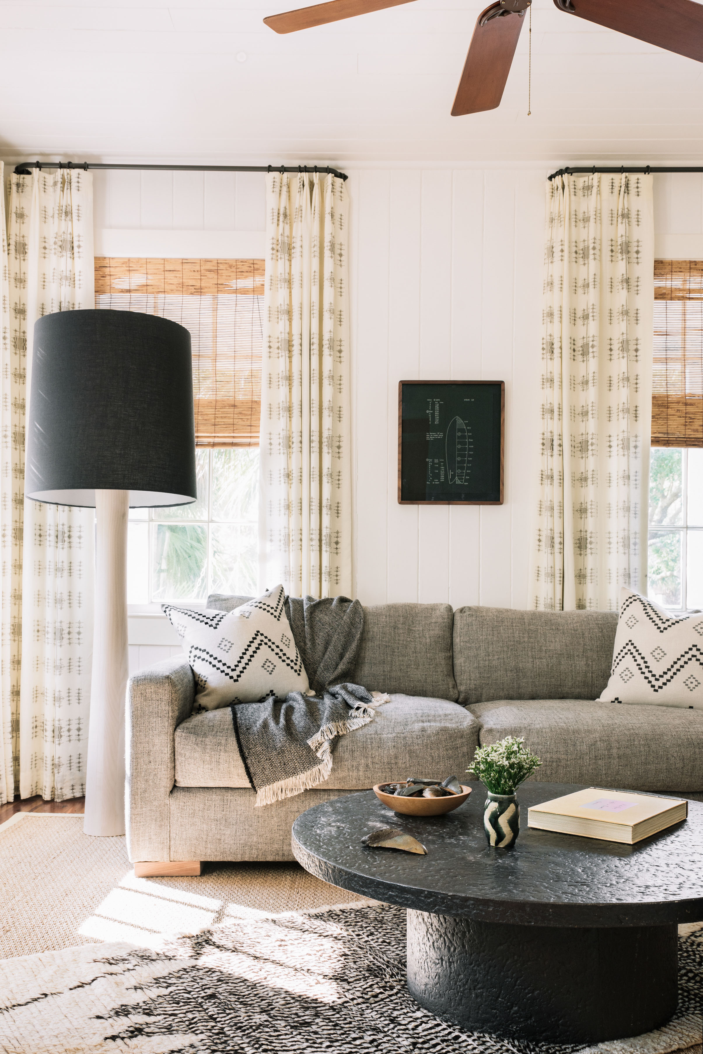 gray couch and round coffee table south carolina beach house