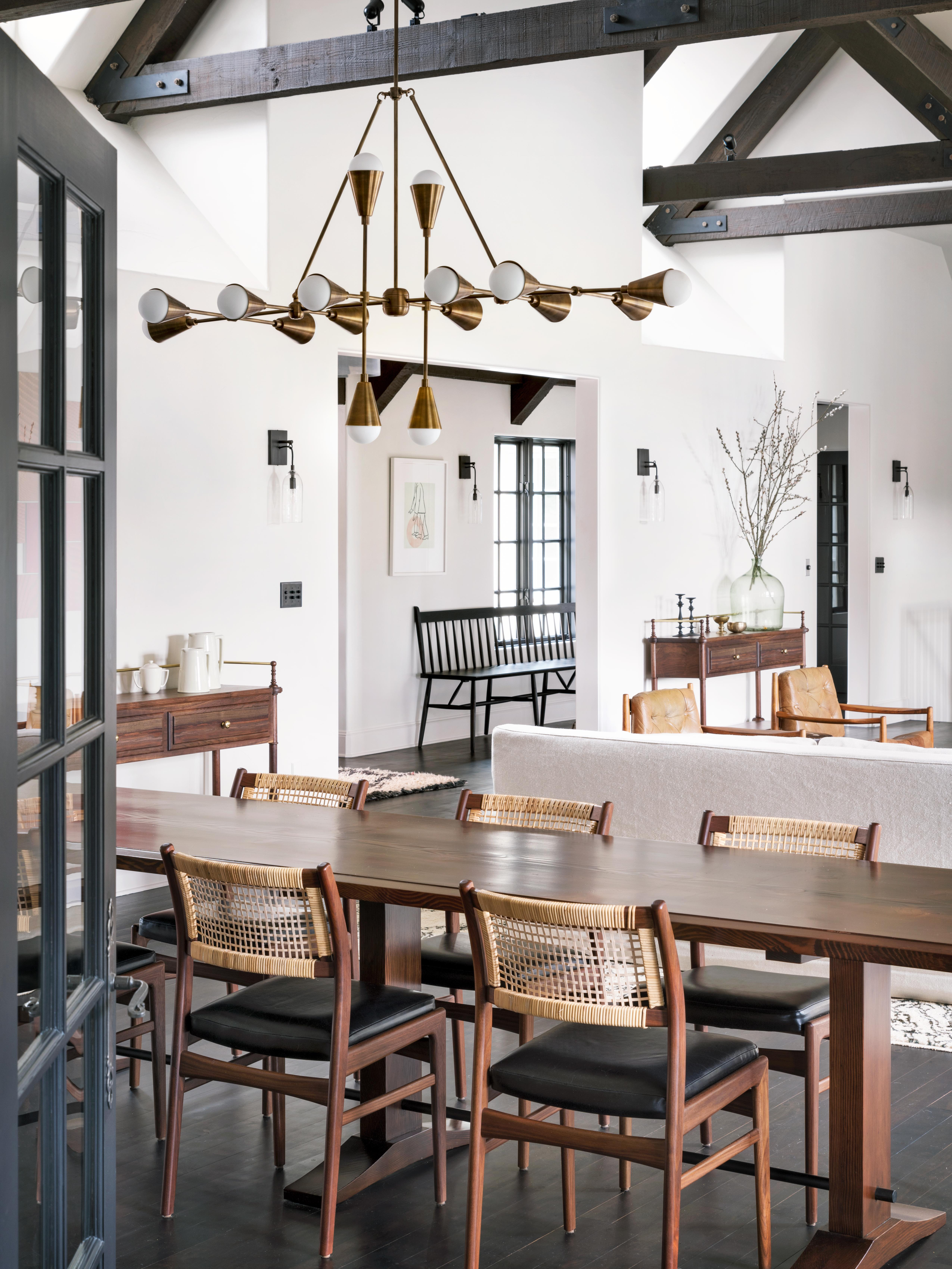 dining area douglas fir table and apparatus light fixture in gold