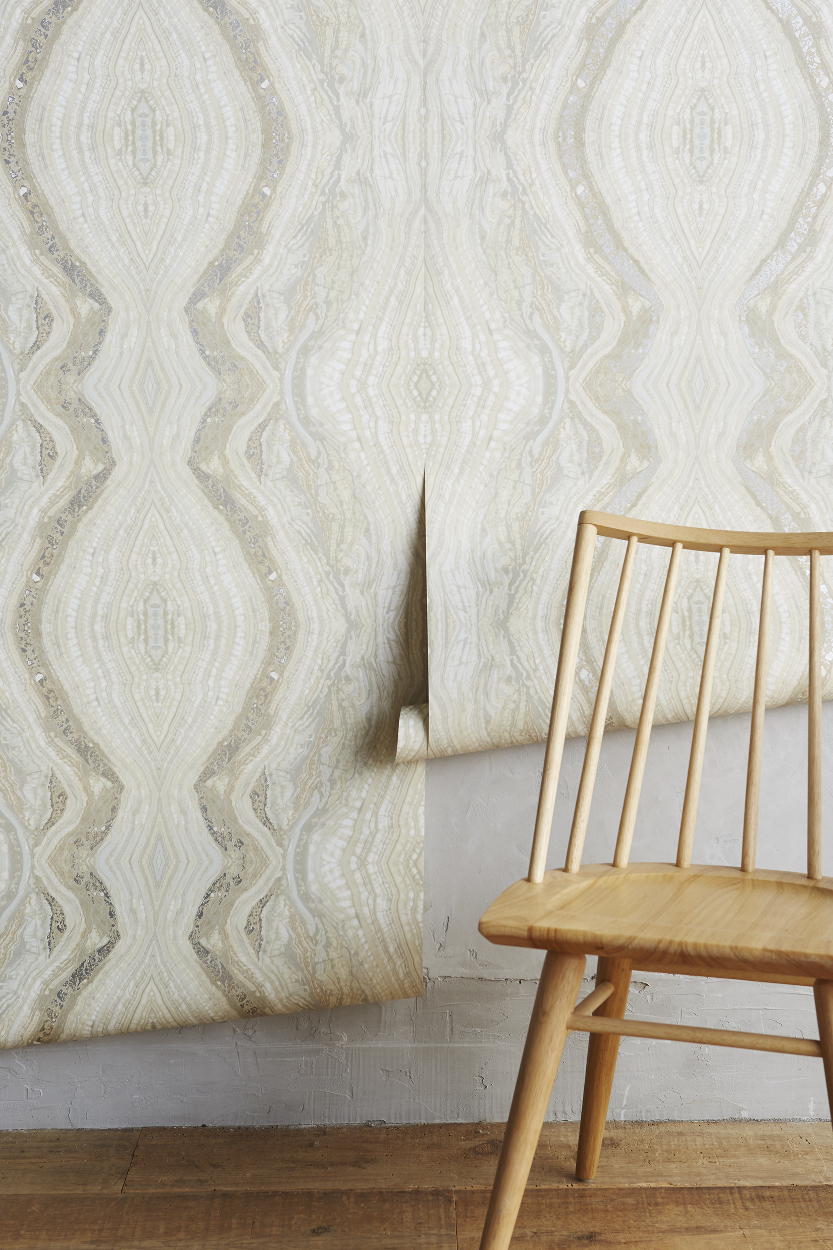 beige wallpaper and wooden chair